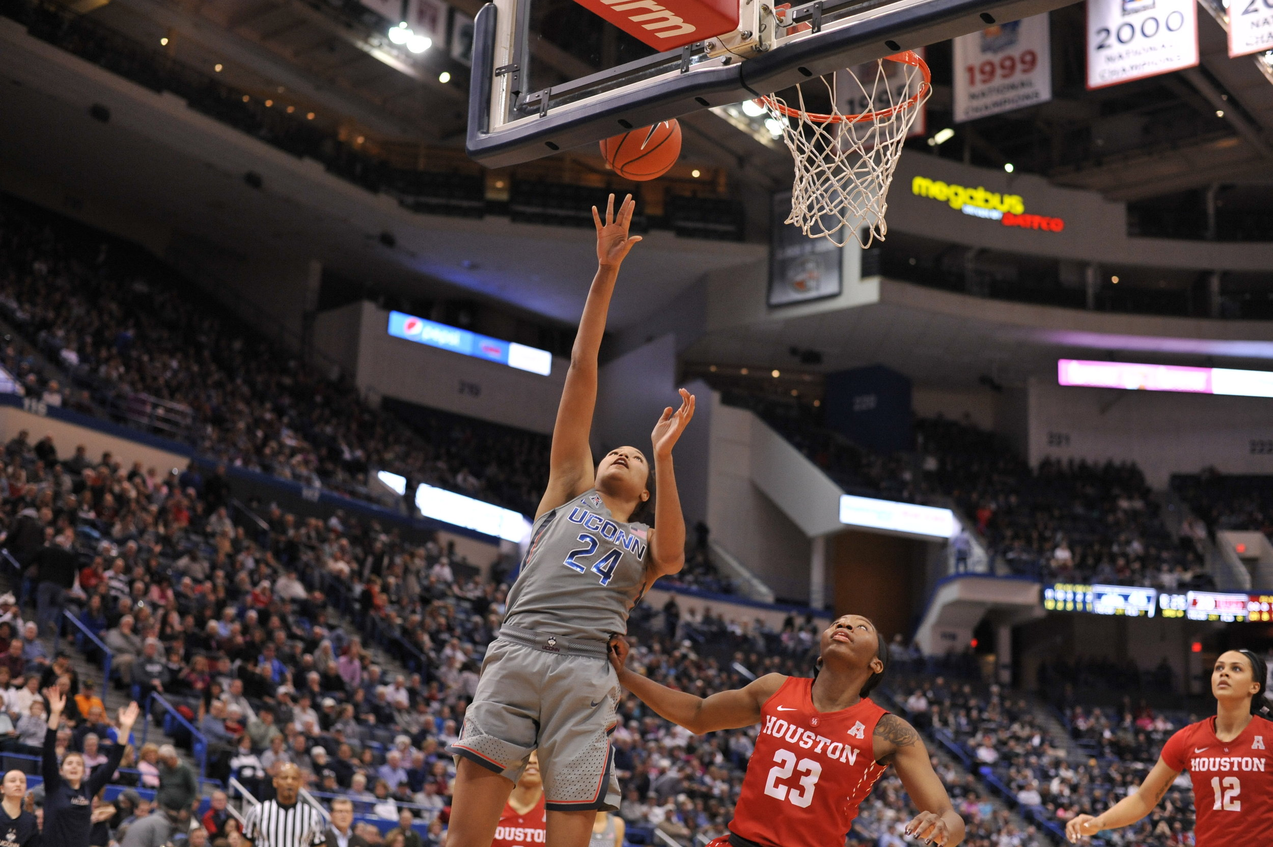 Sophomore Napheesa Collier, who scored 12 points for the Huskies, takes a layup. (Jason Jiang/The Daily Campus)