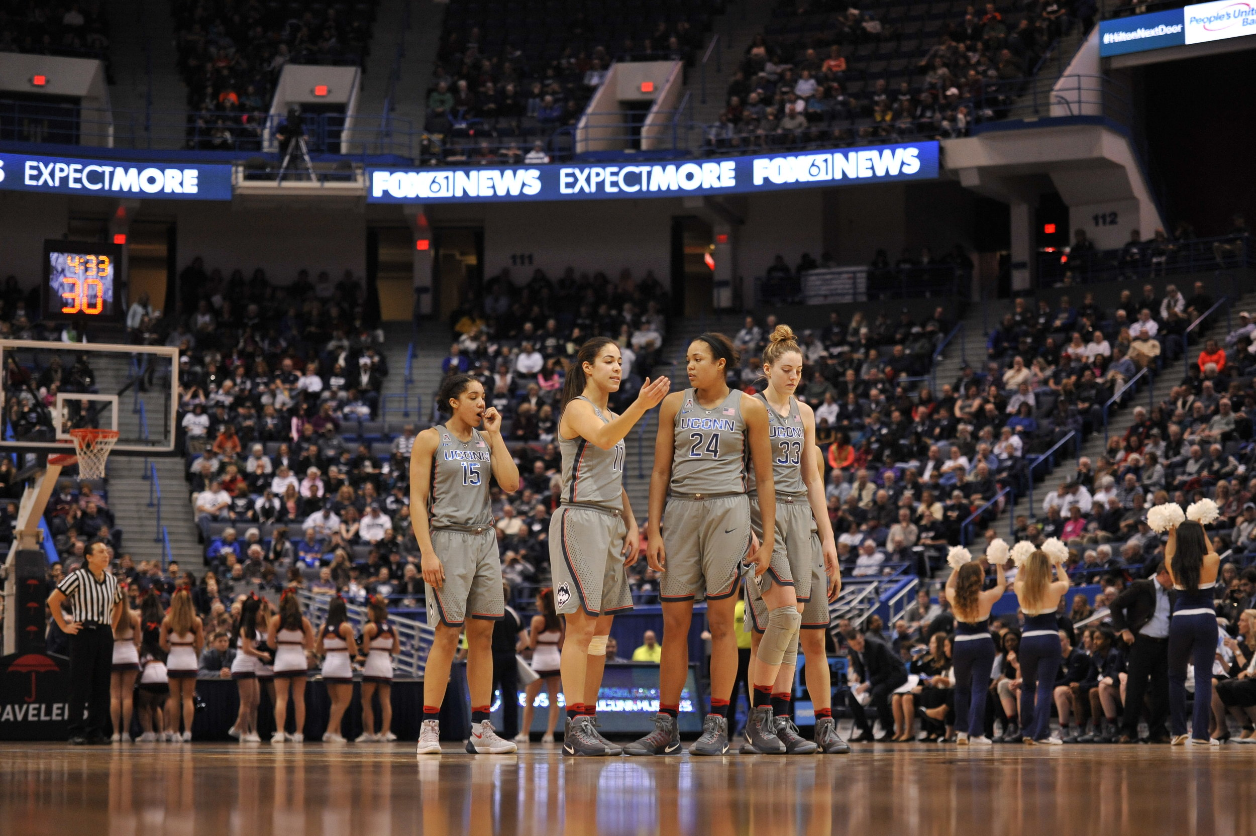 Junior Gabby Williams, junior Kia Nurse, sophomore Napheesa Collier and sophomore Katie Lou Samuelson stand at half court. (Jason Jiang/The Daily Campus)