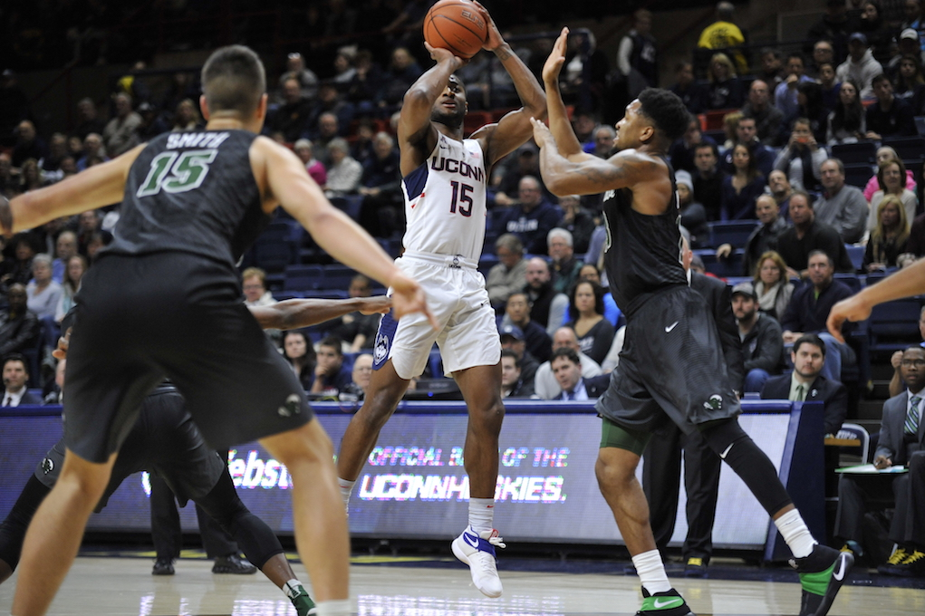 Rodney Purvis squares up for a shot while being defended by two Tulane players in Saturday's victory at Gampel Pavilion. (Jason Jiang/The Daily Campus)