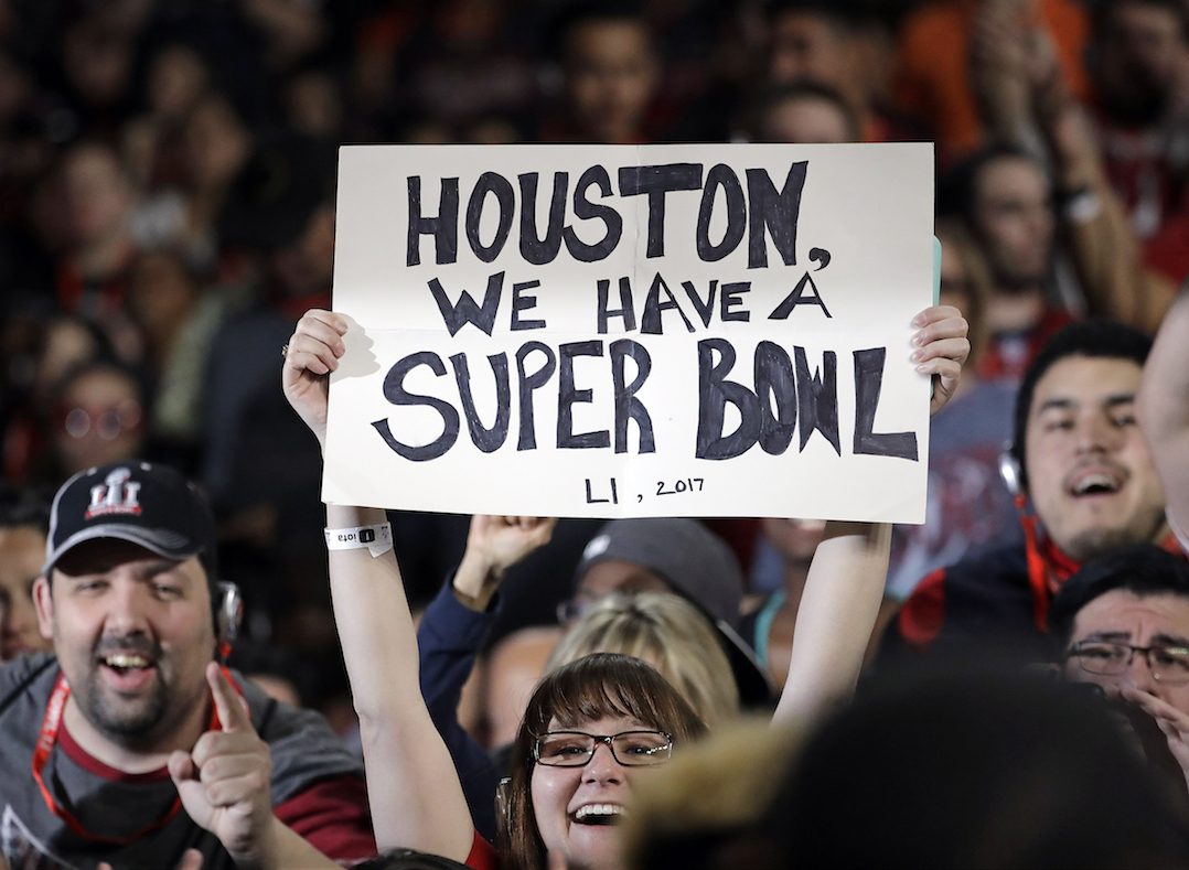 A fan holds a sign during opening night for the NFL Super Bowl 51 football game between the New England Patriots and the Atlanta Falcons at Minute Maid Park Monday, Jan. 30, 2017, in Houston. (AP Photo/Charlie Riedel)