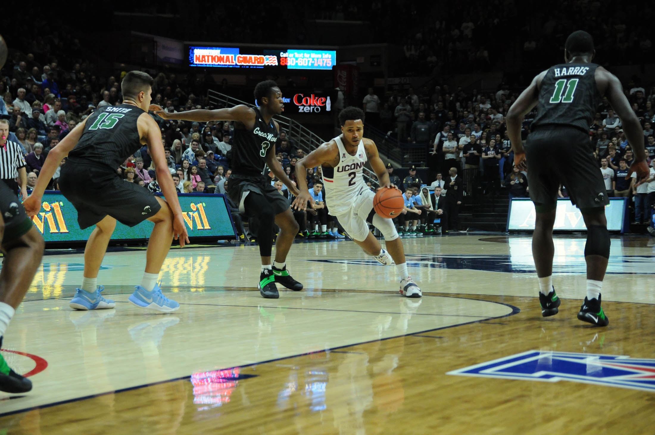 Sophomore guard Jalen Adams avoids a Tulane defender during the Huskies 78-68 victory over the Green Wave Saturday. Jan. 28, 2016 in Gampel Pavilion. (Olivia Stenger/The Daily Campus)