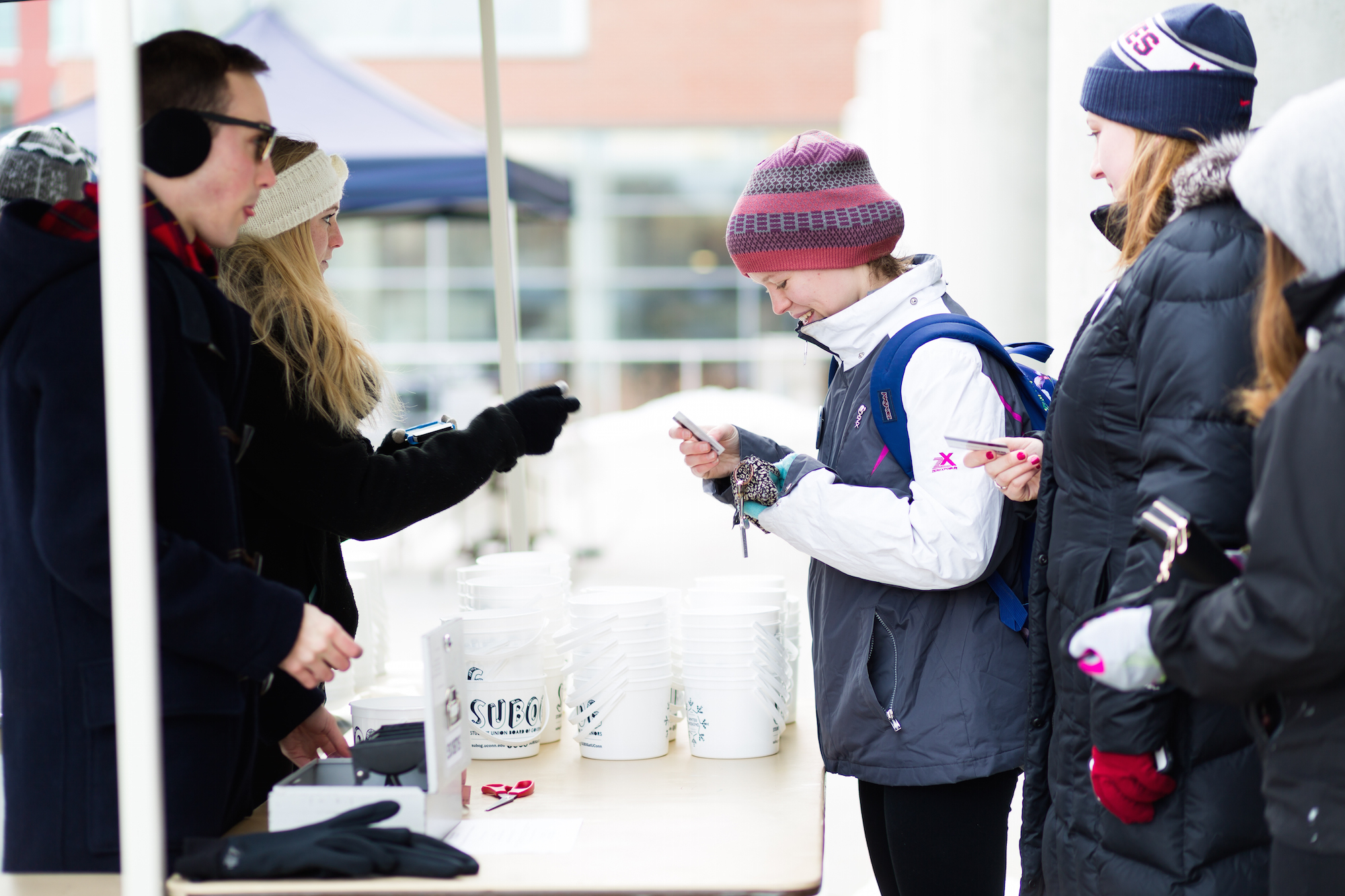SUBOG hosts there annual One Ton Sundae ice cream event Friday afternoon in Storrs. Students line up to fill there buckets with as much ice cream as they would like. (Tyler Benton/The Daily Campus)