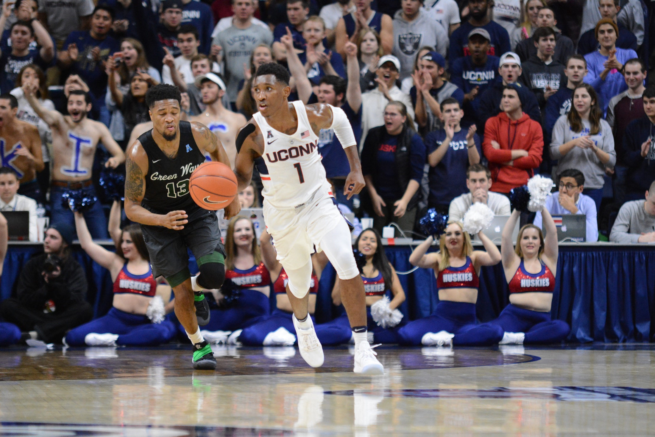 Christian Vital dribbles up the court in UConn's game against Tulane on January 28th, 2017. (Jason Jiang/The Daily Campus)