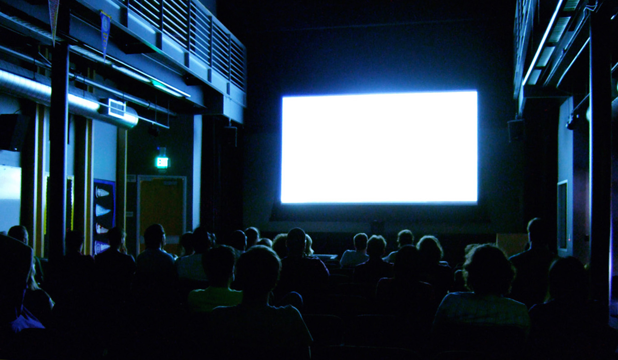 An audience watching a movie at the movie theater. Several well known books have been adapted into movies for this coming year. (Kenneth Lu/Creative Commons)