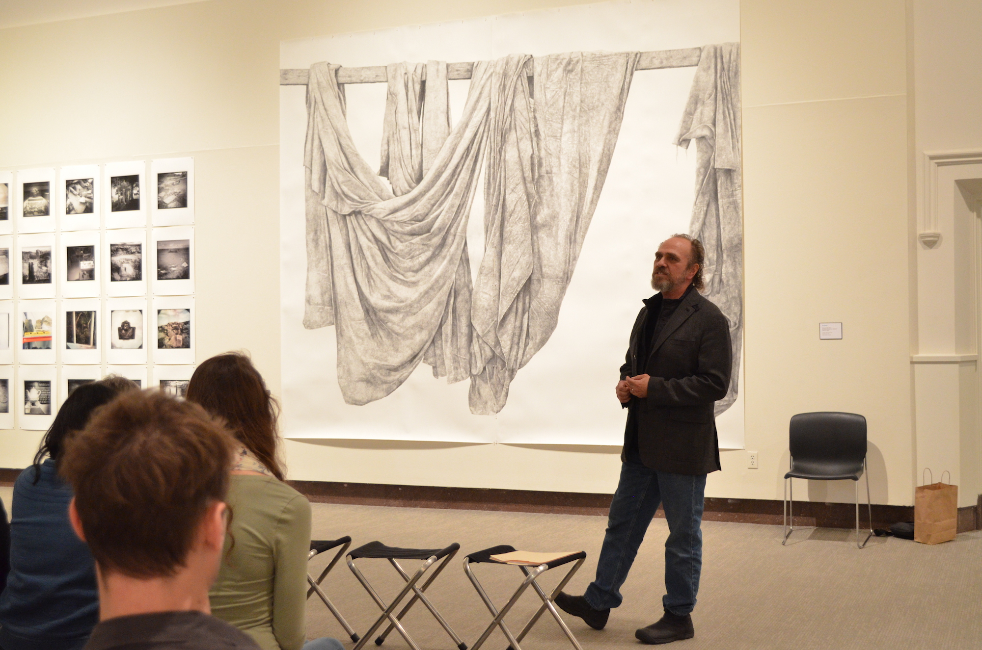 UConn Associate Professor of Sculpture and Drawing Ray DiCapura presents a background of one of his pieces and answers questions from the audience at the Benton on Wednesday, February 8. DiCapura is a two-time McDowell Colony resident and has exhibited his works at the Smithsonian in Washington, DC. (Akshara Thejawsi/The Daily Campus)