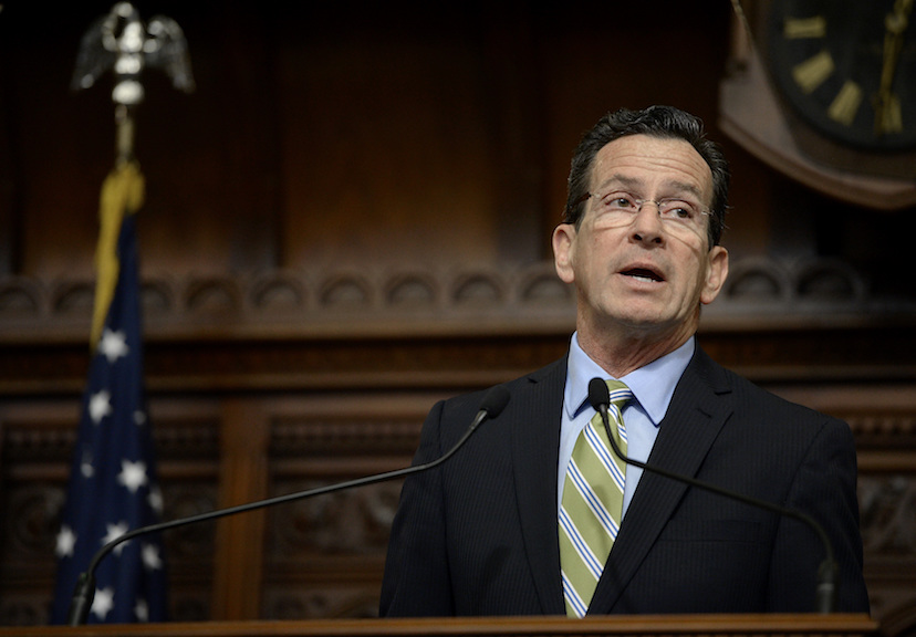 Connecticut Gov. Dannel P. Malloy delivers his budget address to members of the house and senate inside the Hall of the House at the state Capitol in Hartford, Conn., Wednesday, Feb. 8, 2017. (AP Photo/Jessica Hill)