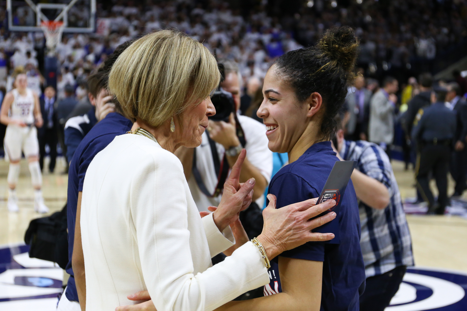 Kia Nurse (right) and Chris Dailey share a laugh after the game. (Jackson Haigis/The Daily Campus)