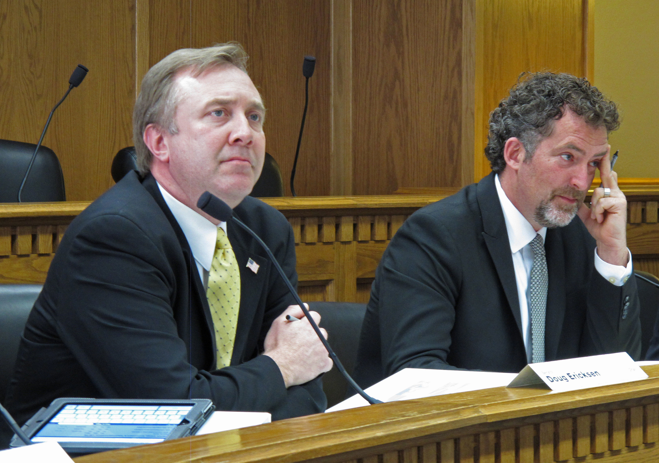 In this March 26, 2013 file photo, Republican state Sen. Doug Ericksen, left, and Democratic state Sen. Kevin Ranker listen to testimony from a climate change skeptic at a hearing in Olympia, Wash. Environmentalists are bracing for court battles over what they fear will be an unprecedented wave of rollbacks on policies concerning climate change. (Rachel La Corte/AP)