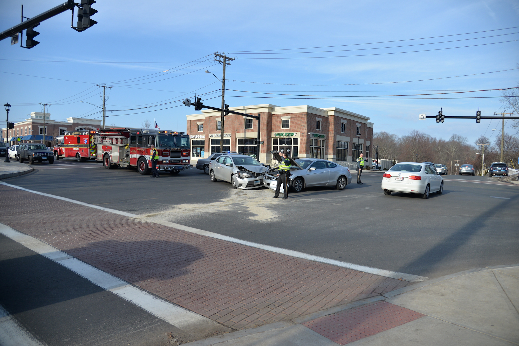 UConn police direct traffic around an accident that occurred at the intersection of South Eagleville Road and Interstate 95 on Wednesday afternoon. No one was seriously injured. (Amar Batra/The Daily Campus)