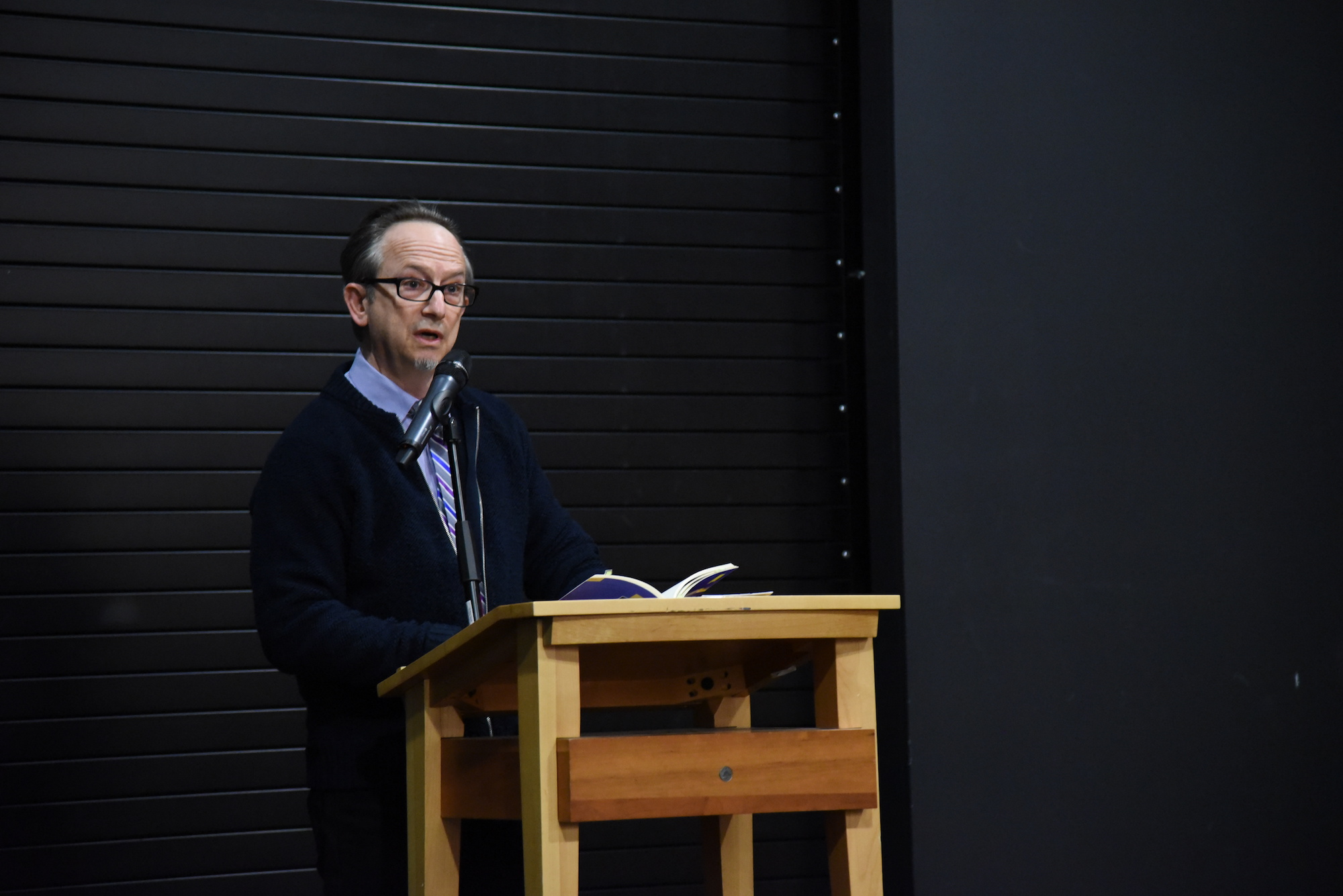 """Barnes and Noble in Storrs Center was full of students and professors listening to author and poet Alan Michael Parker read some of his own publications.He read some of his new poems from """"The Ladder."""" (Charlotte Lao/The Daily Campus)"""