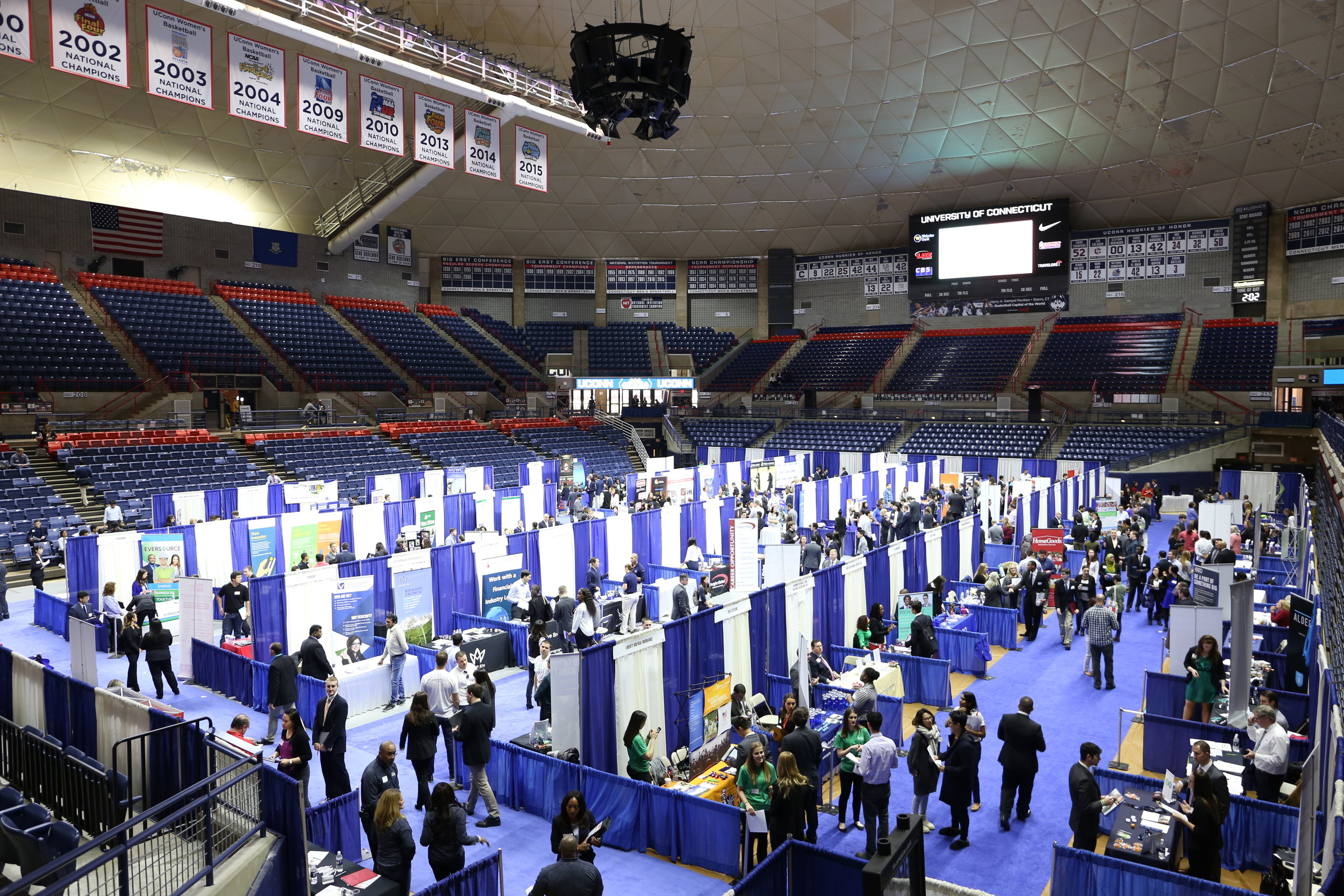 Students navigate UConn's spring career fair, put on by the Center for Career Development in Gampel Pavilion on Wednesday, March 30. Dozens of employers sent representatives to speak with students about full-time opportunities, internships, and more. (Jackson Haigis/The Daily Campus)