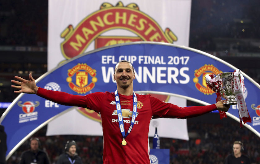 Manchester United's Zlatan Ibrahimovic celebrates with the trophy after his side won the League Cup Final soccer match by beating Southampton 3-2 at Wembley Stadium, London, Sunday Feb. 26, 2017. (Nick Potts/PA via AP)