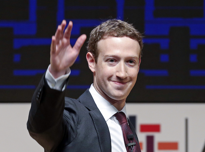 In this Nov. 19, 2016 file photo, Mark Zuckerberg, chairman and CEO of Facebook, waves at the CEO summit during the annual Asia Pacific Economic Cooperation (APEC) forum in Lima, Peru. Zuckerberg released a missive Thursday, Feb. 16, 2017, outlining his vision for the social network and the world at large. (AP Photo/Esteban Felix, File)