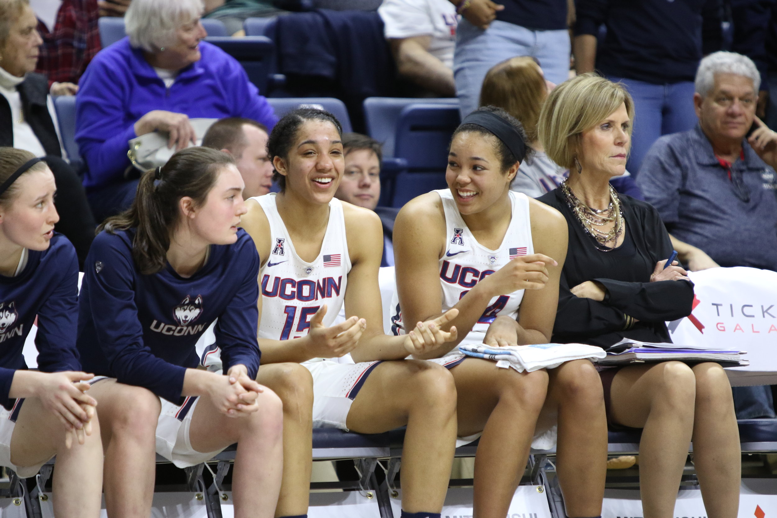 From left: Players Tierney Lawlor, Molly Bent, Gabby Williams and Napheesa Collier sit on the bench while coach Chris Dailey looks on in UConn's 91-48 win over Memphis on Feb. 25, 2017 at Gampel Pavilion (Jackson Haigis/The Daily Campus).