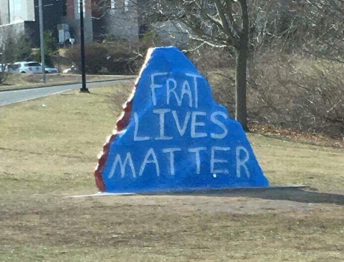 "The rock beside North Garage was painted ""Frat Lives Matter"" on the night on Feb. 27, 2017, a few days after several members of Kappa Sigma fraternity were arrested for serving alcohol to minors in the case of Jeffny Pally. (Contributed Photo/The Daily Campus)"