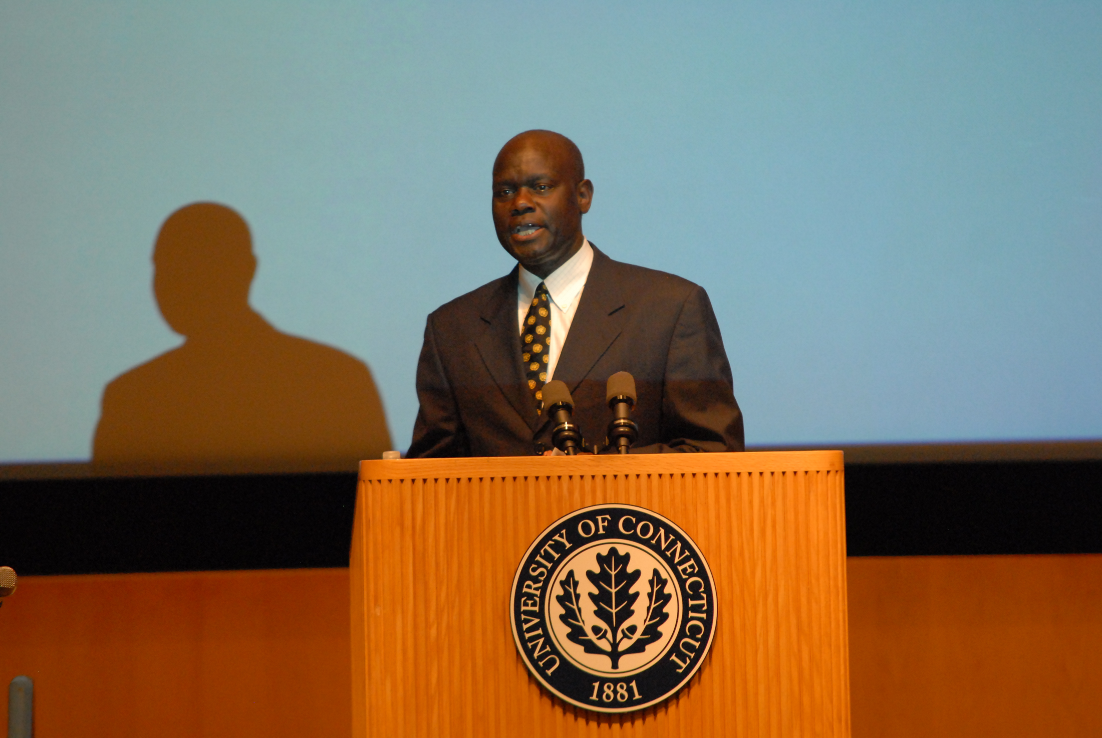 Dr. Amii Omara-Otunnu presents an award top a colleague on Sept. 11, 2012. He has recently been removed from his post as the UNESCO chair at UConn. (File Photo/The Daily Campus)