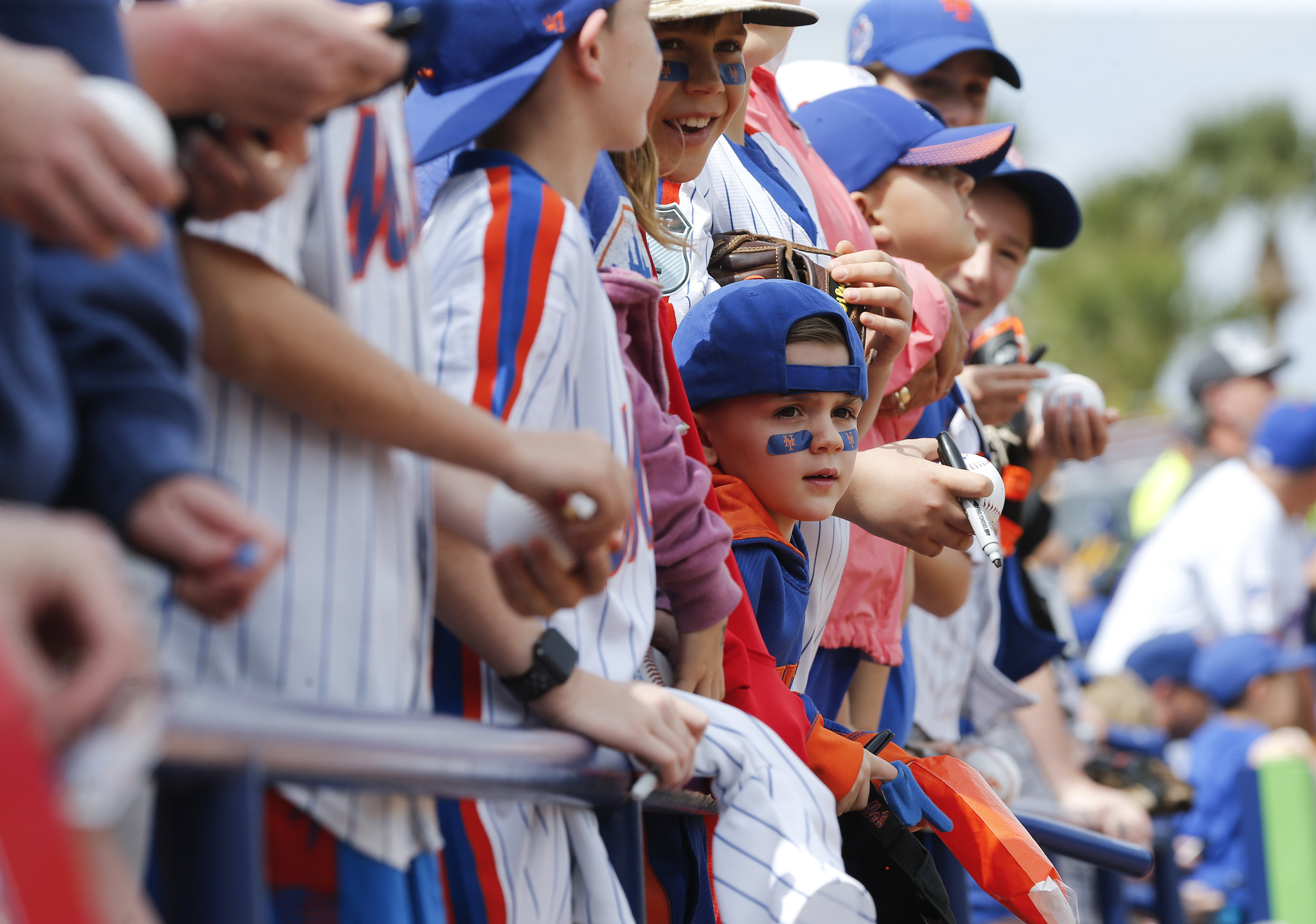 Young fans wait for autographs before a spring training baseball game between the New York Mets and the Houston Astros, Friday, March 3, 2017, in Port St. Lucie, Fla. (AP Photo/John Bazemore)