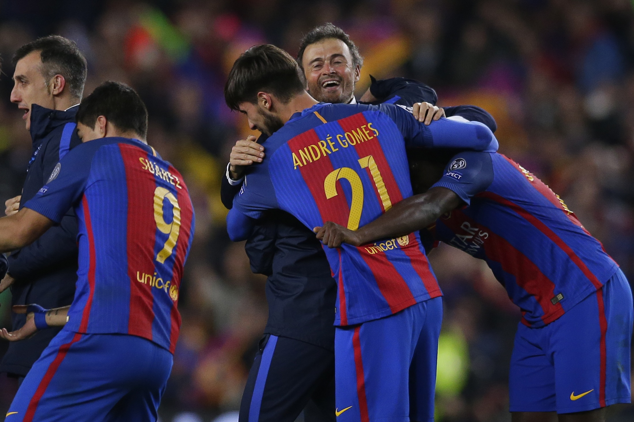 Barcelona's head coach Luis Enrique celebrates with some of his players at the end of the Champions League round of 16, second leg soccer match between FC Barcelona and Paris Saint Germain at the Camp Nou stadium inBarcelona, Spain, Wednesday March 8, 2017.Barcelona won the match 6-1 (6-5 on aggregate). (Manu Fernandez/AP)