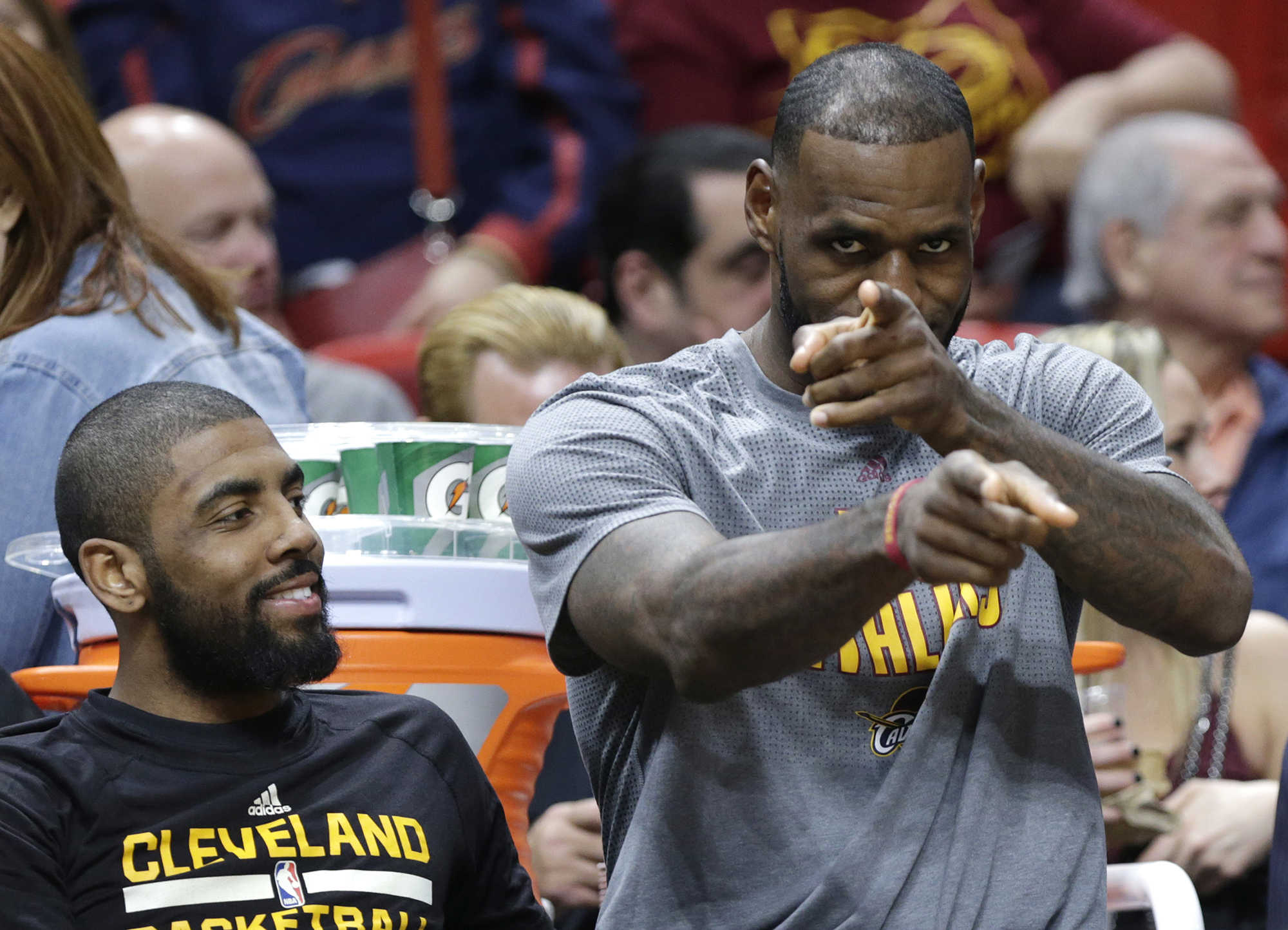 Cleveland Cavaliers' LeBron James, right, gestures as he sits with Kyrie Irving, left, on the bench during the first half of an NBA basketball game against the Miami Heat, Saturday, March 4, 2017, in Miami. (Lynne Sladky/AP)