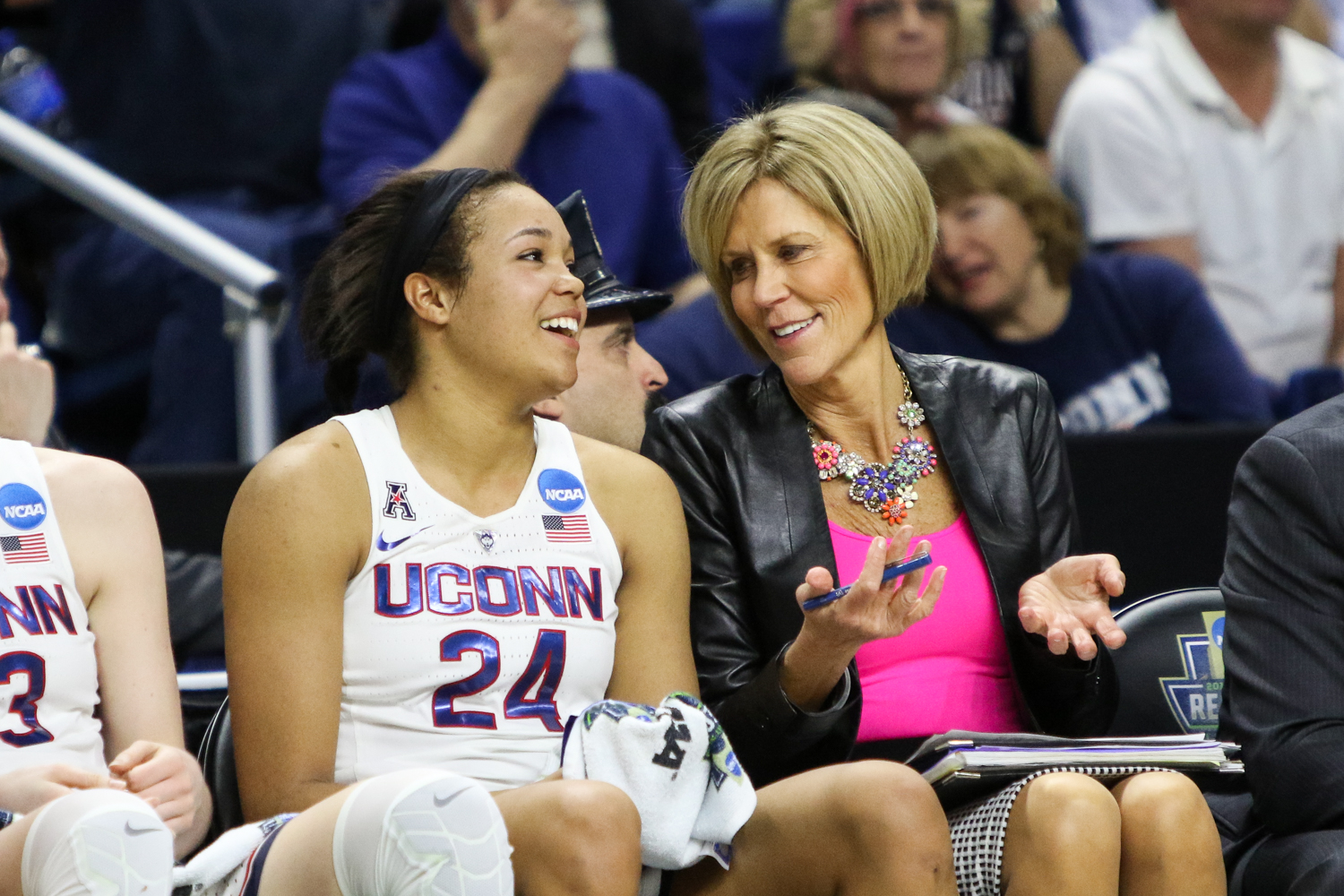 UConn's Napheesa Collier and assistant coach Chris Dailey share a laugh in the fourth quarter of the Huskies' win.