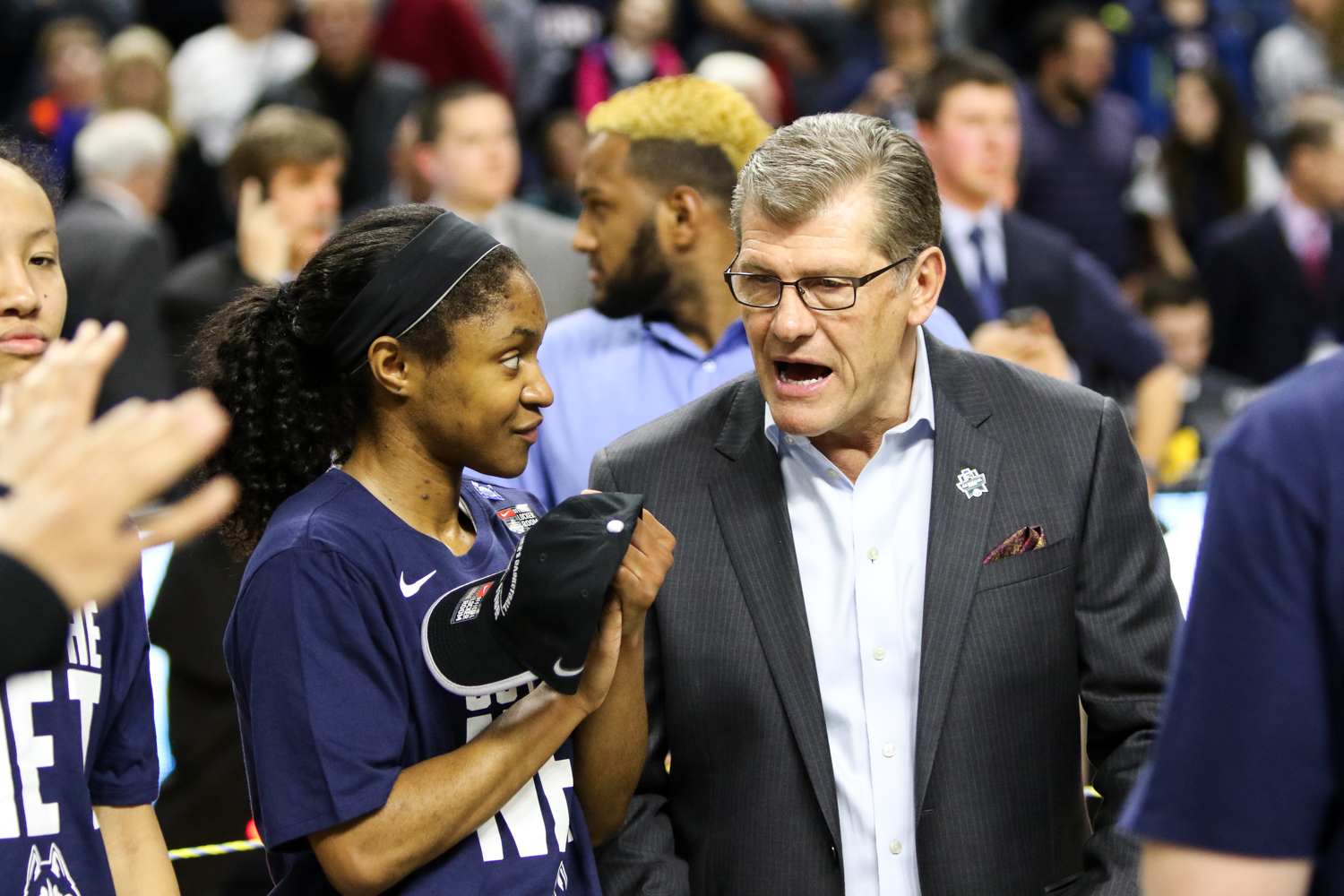 UConn freshman Crystal Dangerfield and head coach Geno Auriemma chat during the postgame celebration.