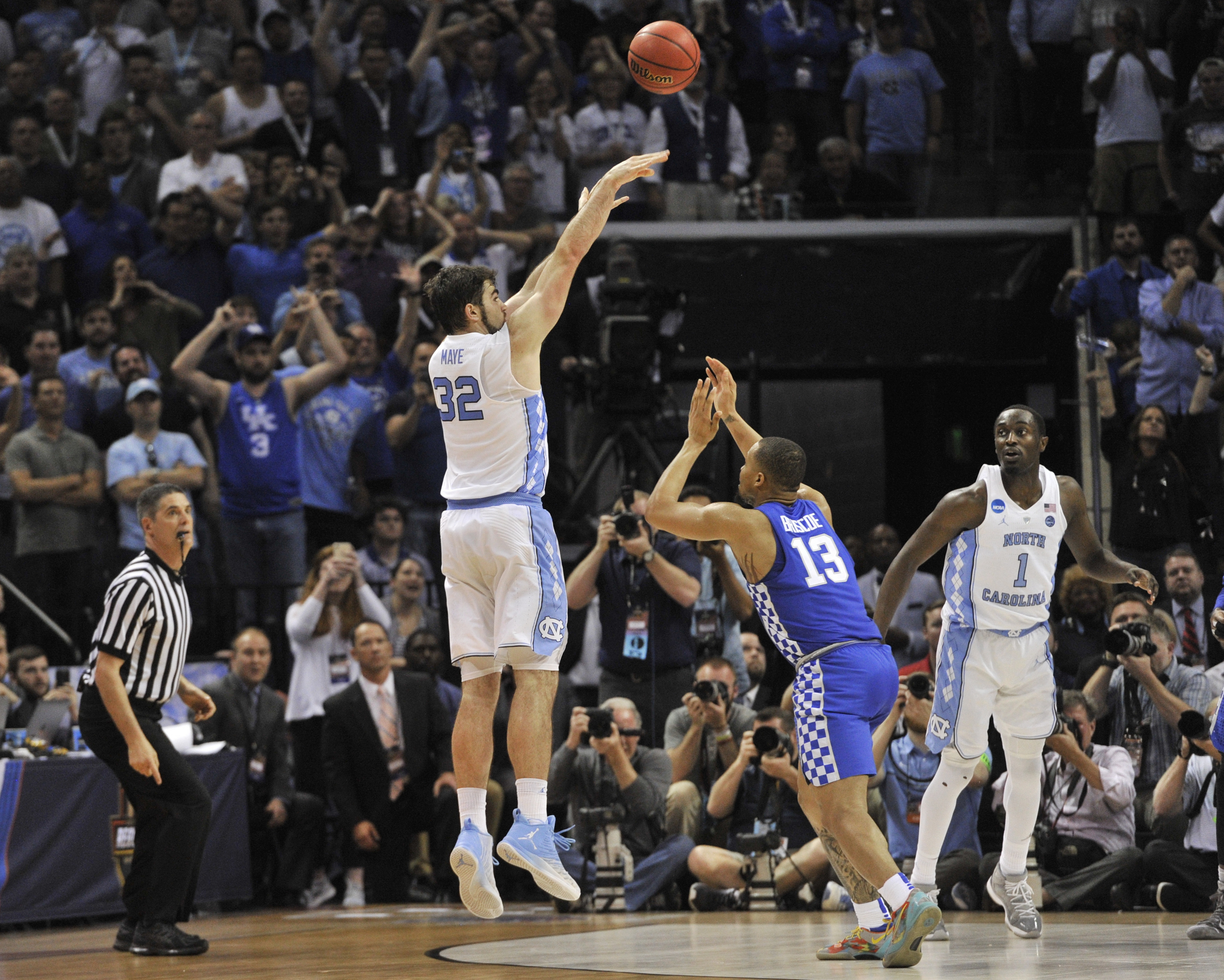 North Carolina forward Luke Maye (32) shoots the winning basket as Kentucky guard Isaiah Briscoe (13) defends in the second half of the South Regional final game in the NCAA college basketball tournament Sunday, March 26, 2017, in Memphis, TN. (Brandon Dill/AP)
