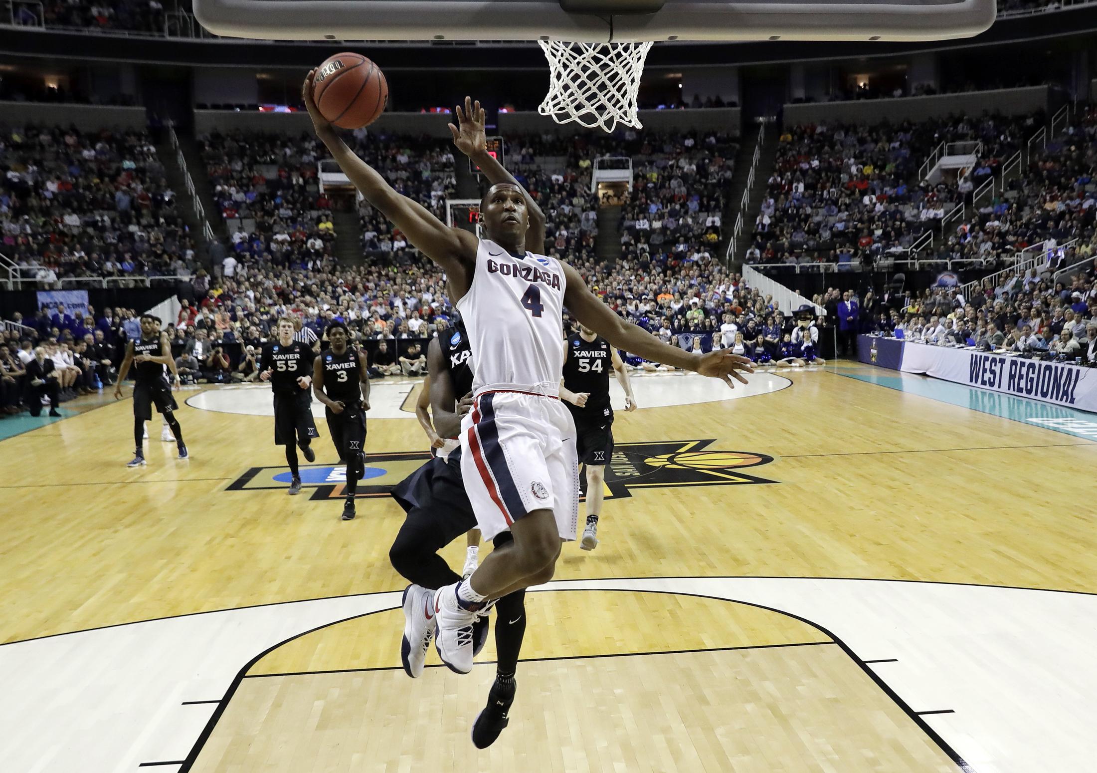 Gonzaga guard Jordan Mathews (4) drives to the basket against Xavier during the second half of an NCAA Tournament college basketball regional final game Saturday, March 25, 2017, in San Jose, Calif. (Tony Avelar/AP)