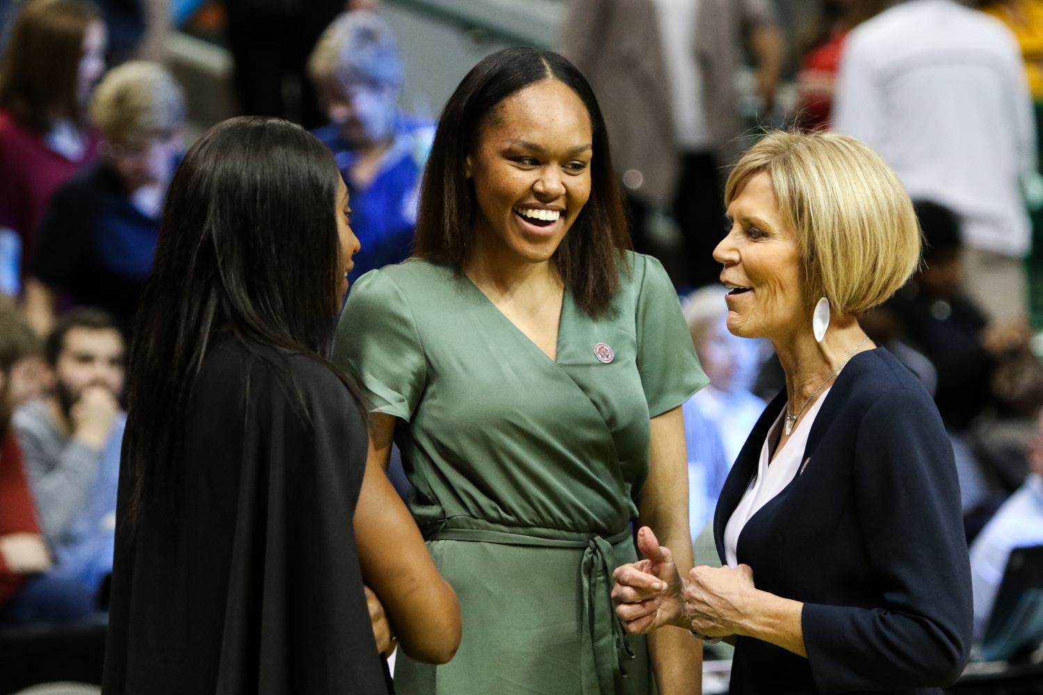 UConn's' Batouly Camara (left) and Azura Stevens (center) share a laugh with assistant coach Chris Dailey before the Huskies' Final Four matchup with Mississippi State on March 31, 2017. (Jackson Haigis/The Daily Campus)