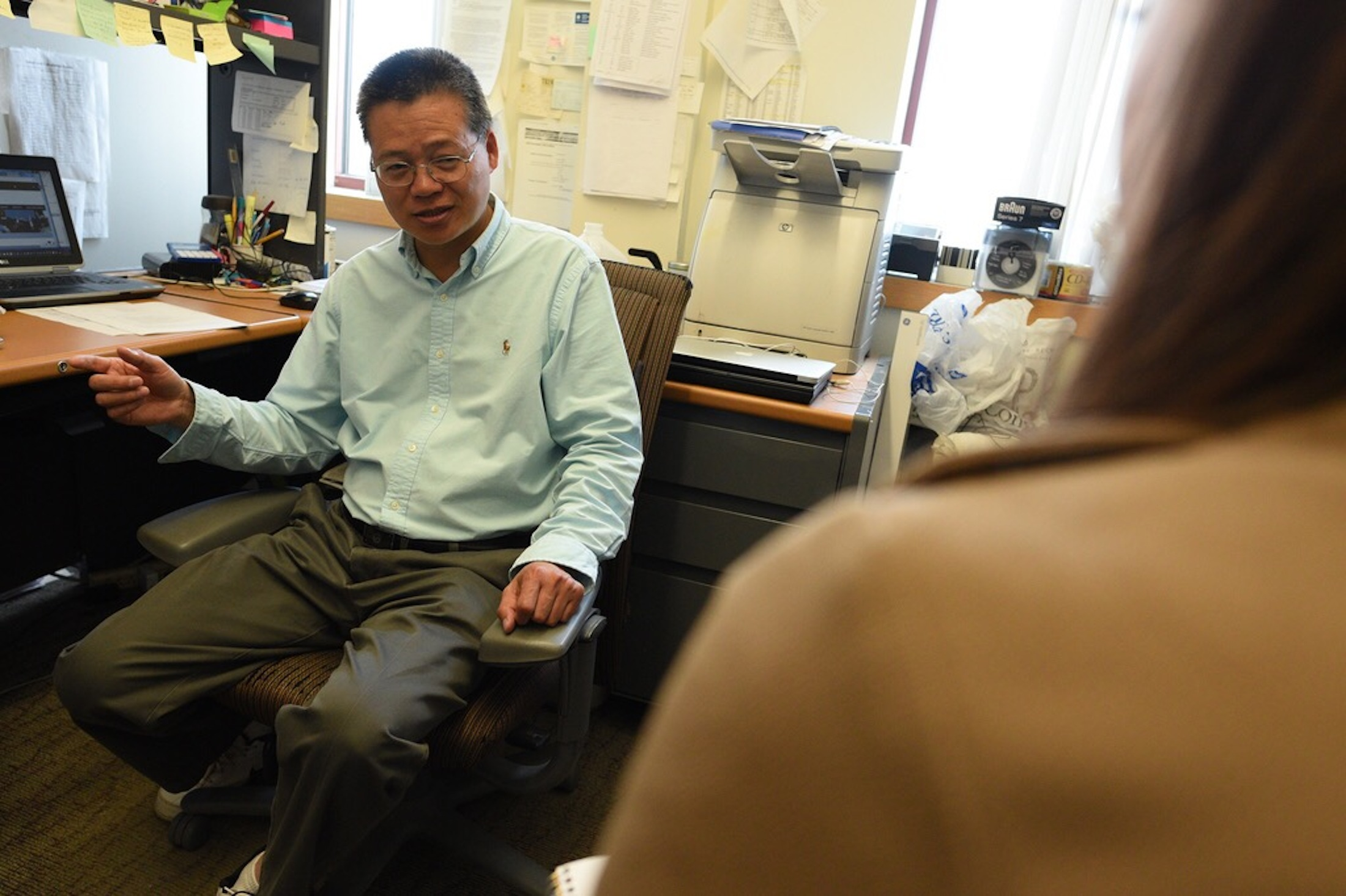 Laijun Lai, Associate Research Professor in the Department of Allied Health Sciences at the University of Connecticut, talks about his latest research about cancer to a Daily Campus writer on March 29th.(Zhelun Lang/The Daily Campus)