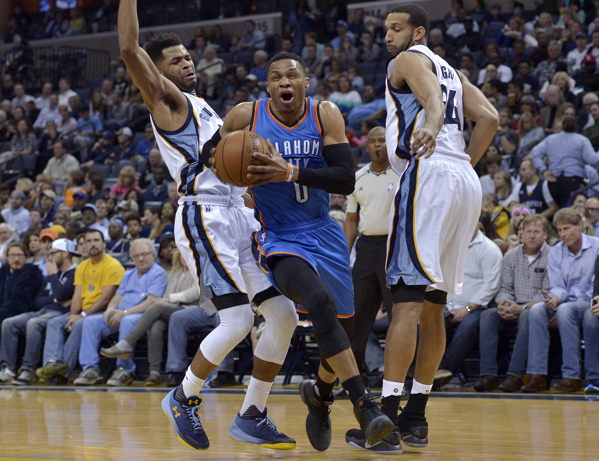 Oklahoma City Thunder guard Russell Westbrook (0) drives between Memphis Grizzlies guard Andrew Harrison, left, and forward Brandan Wright during the first half of an NBA basketball game Wednesday, April 5, 2017, in Memphis, Tenn. (Brandon Dill/AP)