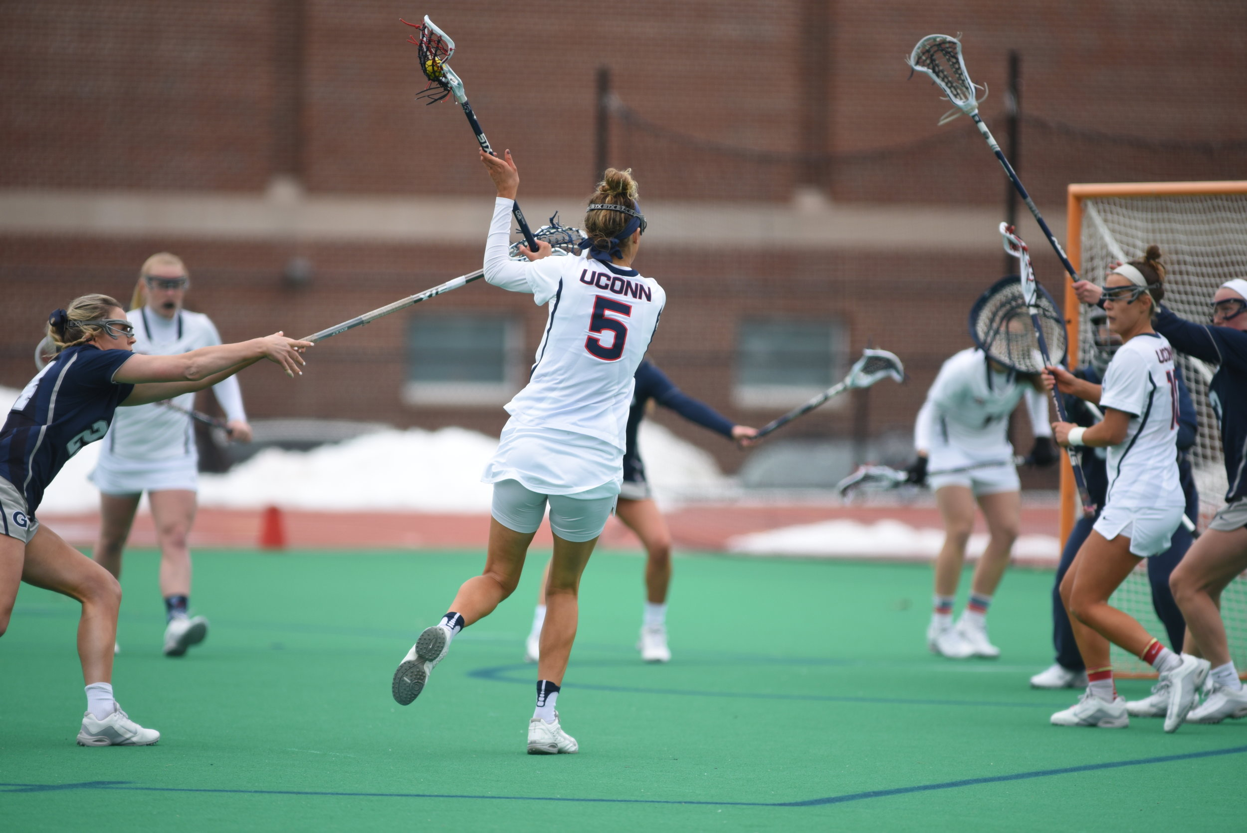Molly O'Reilly (#5) fires a shot on net during UConn's game against Georgetown on March 25, 2017. The Huskies dropped the contest 14-6. (Charlotte Lao/The Daily Campus)