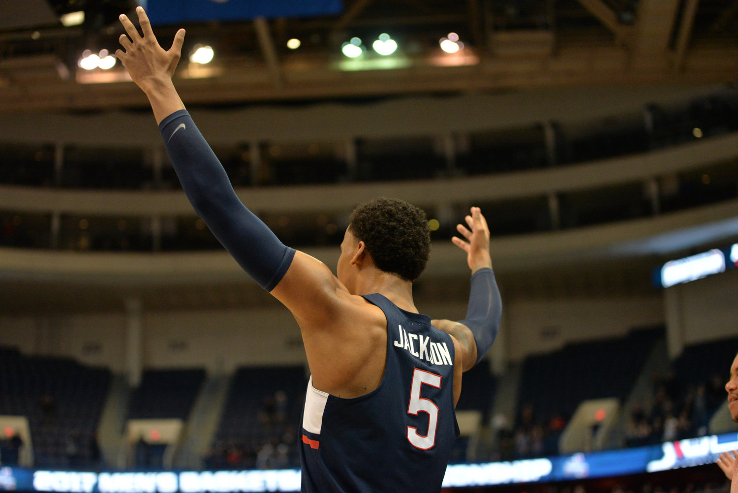 Vance Jackson waves his arms to pump up the hometown crowd in UConn's 74-65 win over Houston in the second round of the American Athletic Conference tournament on Friday, March 10, 2017 at the XL Center in Hartford. (Amar Batra/The Daily Campus)