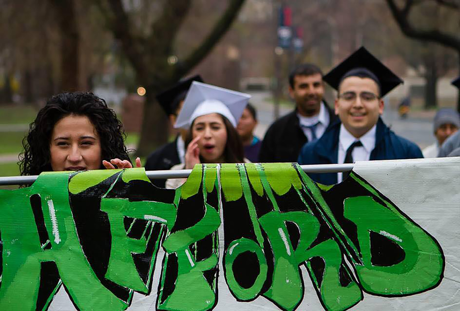 Alison Martinez-Carrasco (middle) walks in front of the Connecticut State Capitol in Hartford, Connecticut during a rally supporting the Afford to Dream campaign in 2014. (Courtesy/Morty Ortega)