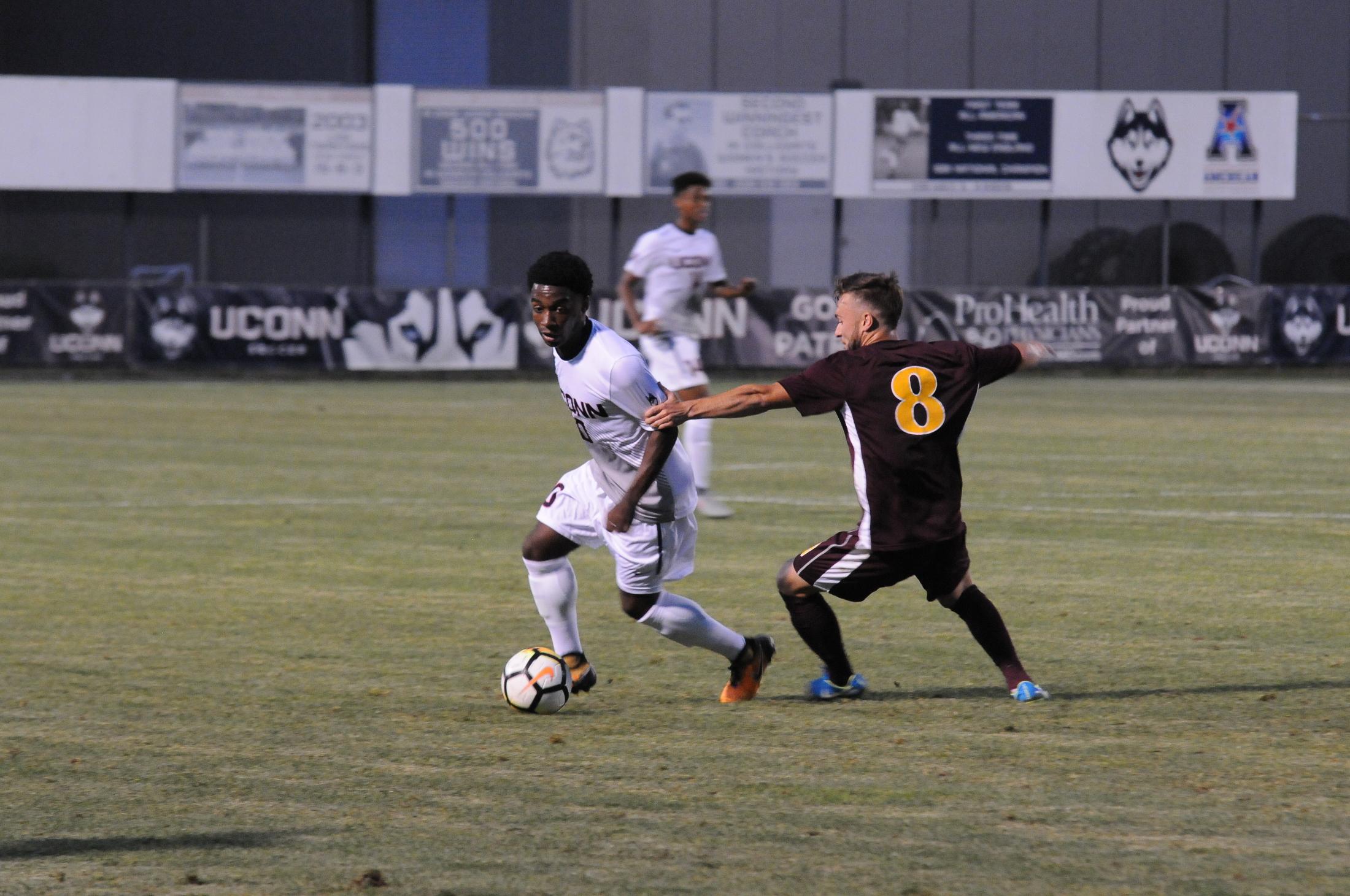 Freshman Josh Burnett makes a move on the Iona defense. (Olivia Stenger/The Daily Campus)