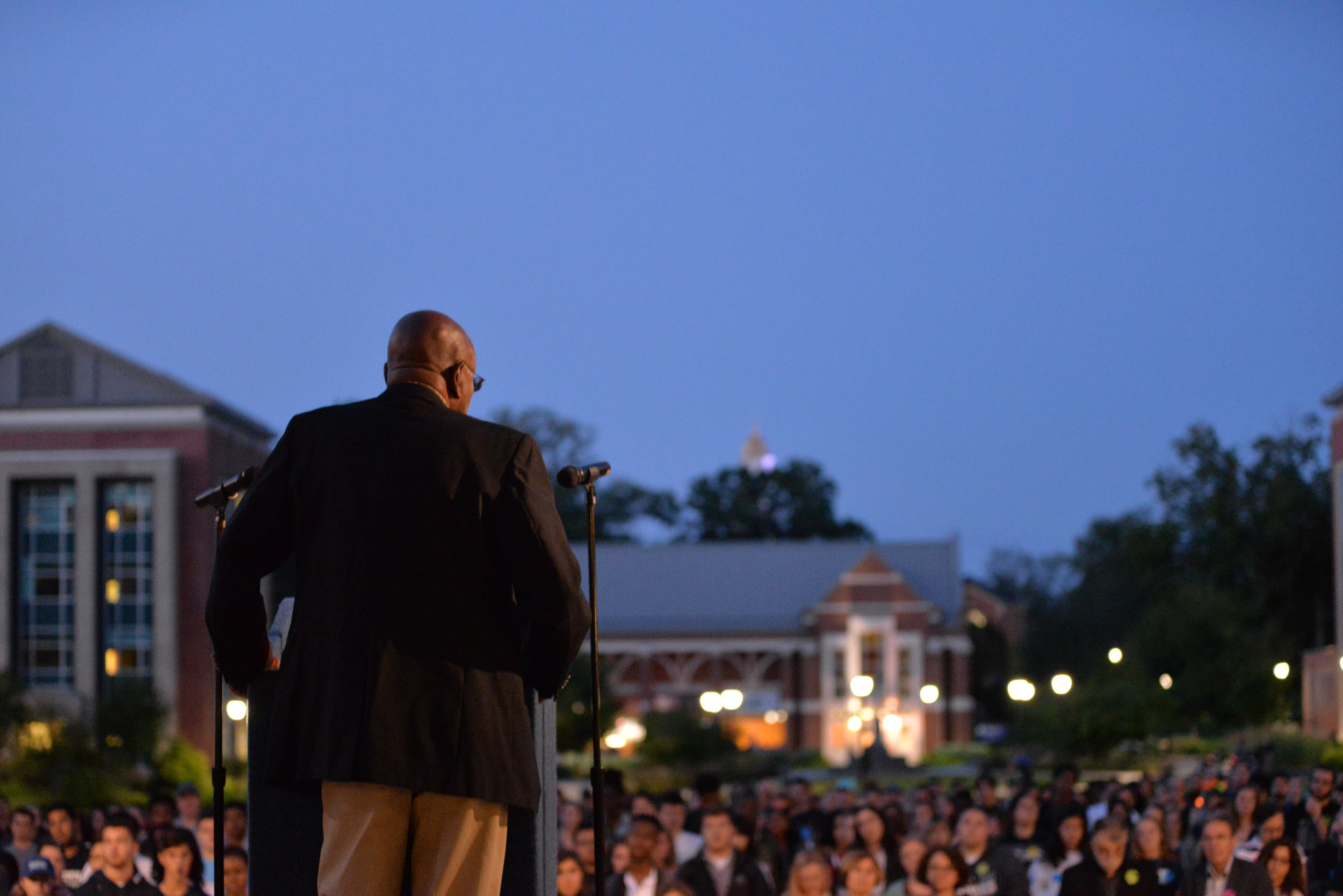 Accounting professor Mohamed E. Hussein addresses the vigil on the Student Union Quad. (Amar Batra/TheDaily Campus)