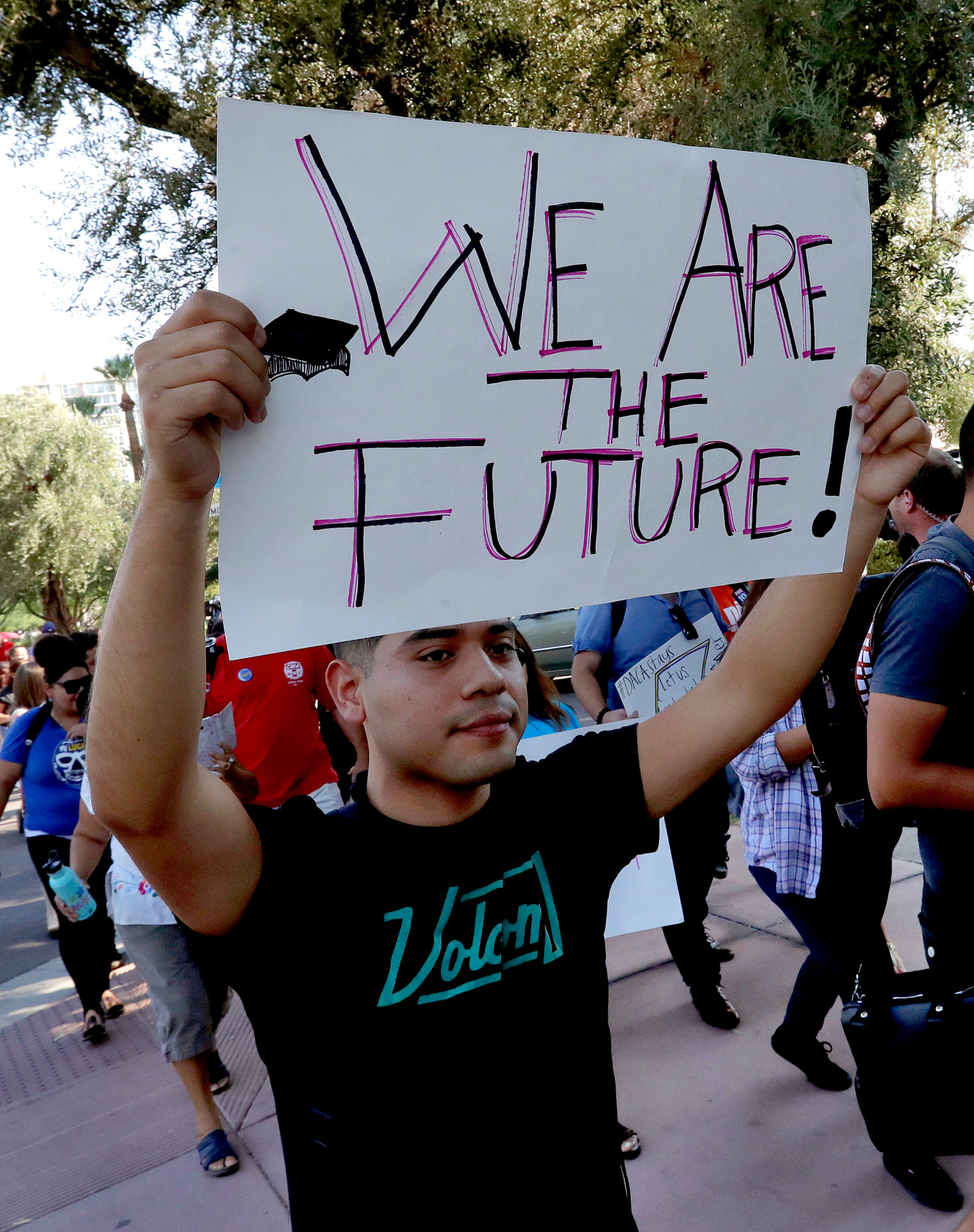 Deferred Action for Childhood Arrivals (DACA) supporters march to the Immigration and Customs Enforcement office to protest shortly after U.S. Attorney General Jeff Sessions' announcement that the Deferred Action for Childhood Arrivals (DACA), will be suspended with a six-month delay, Tuesday, Sept. 5, 2017, in Phoenix. President Donald Trump on Tuesday began dismantling the Deferred Action for Childhood Arrivals, or DACA, program, the government program protecting hundreds of thousands of young immigrants who were brought into the country illegally as children. (AP Photo/Matt York)