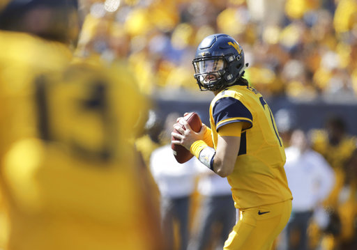 West Virginia quarterback Will Grier (7) looks for an open receiver during the second half of an NCAA college football game against East Carolina, Saturday, Sept. 9, 2017, in Morgantown, W.Va. West Virginia defeated East Carolina 56-20. (AP Photo/Raymond Thompson)