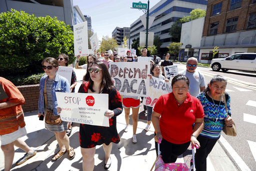 Protesters representing various human rights organizations, immigrants, students and DACA recipients march to the federal building in downtown Jackson, Miss., Friday, Sept. 8, 2017. The group called for Mississippi's senators, Roger Wicker and Thad Cochran, both Republicans, to help protect DACA recipients and pass a DREAM act. The group then marched to the Governor's Mansion and made the same plea. (AP Photo/Rogelio V. Solis)