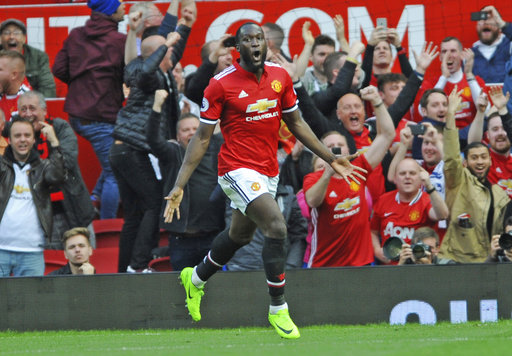 Manchester United's Romelu Lukaku celebrates after scoring his side third goal during the English Premier League soccer match between Manchester United and Everton at Old Trafford in Manchester, England, Sunday, Sept. 17, 2017. (AP Photo/Rui Vieira)
