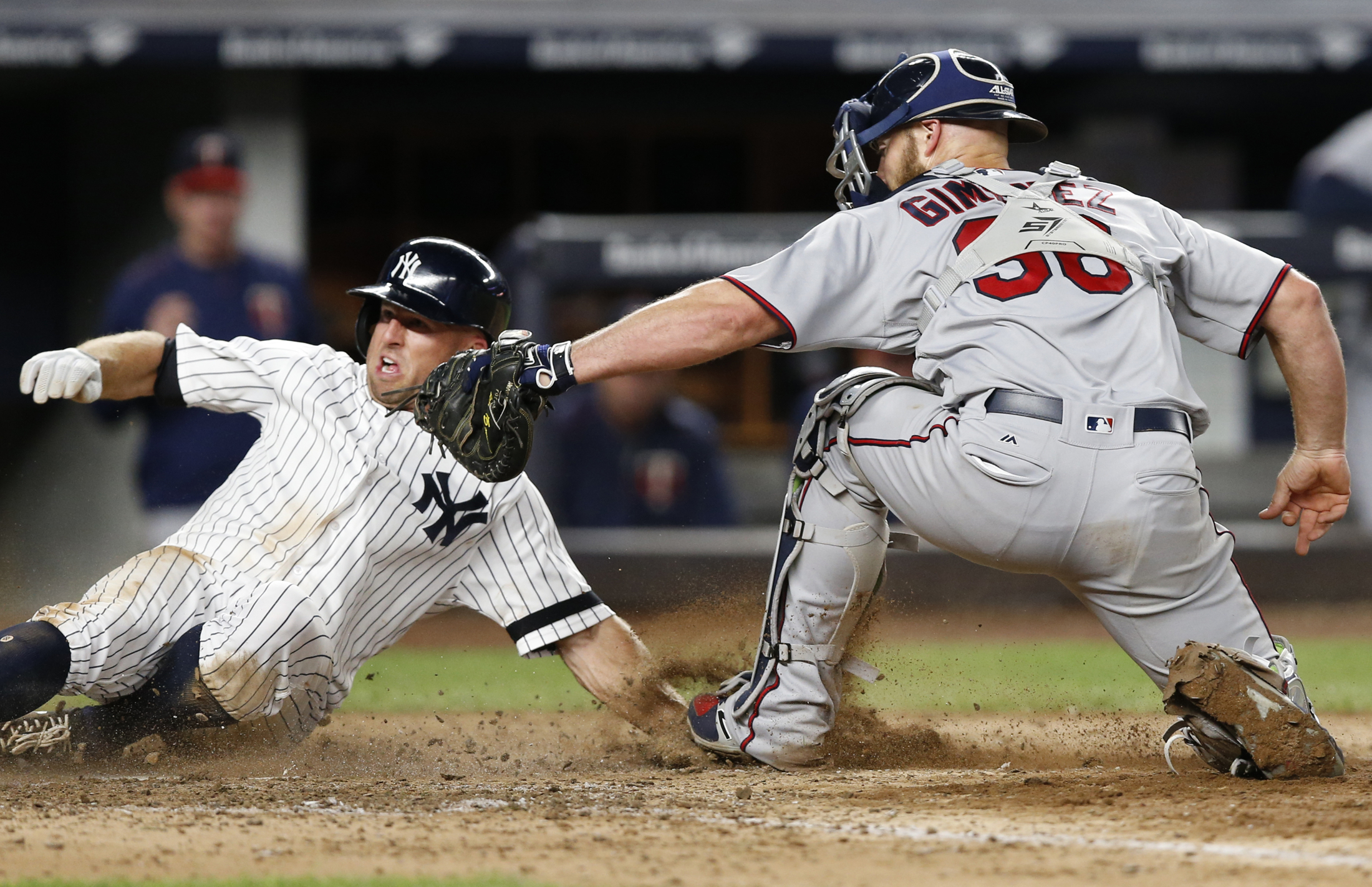 New York Yankees left fielder Brett Gardner (11) reacts after he was tagged out at the plate by Minnesota Twins catcher Chris Gimenez (38) during the seventh inning of a baseball game in New York, Tuesday, Sept. 19, 2017. (Kathy Willens/AP)