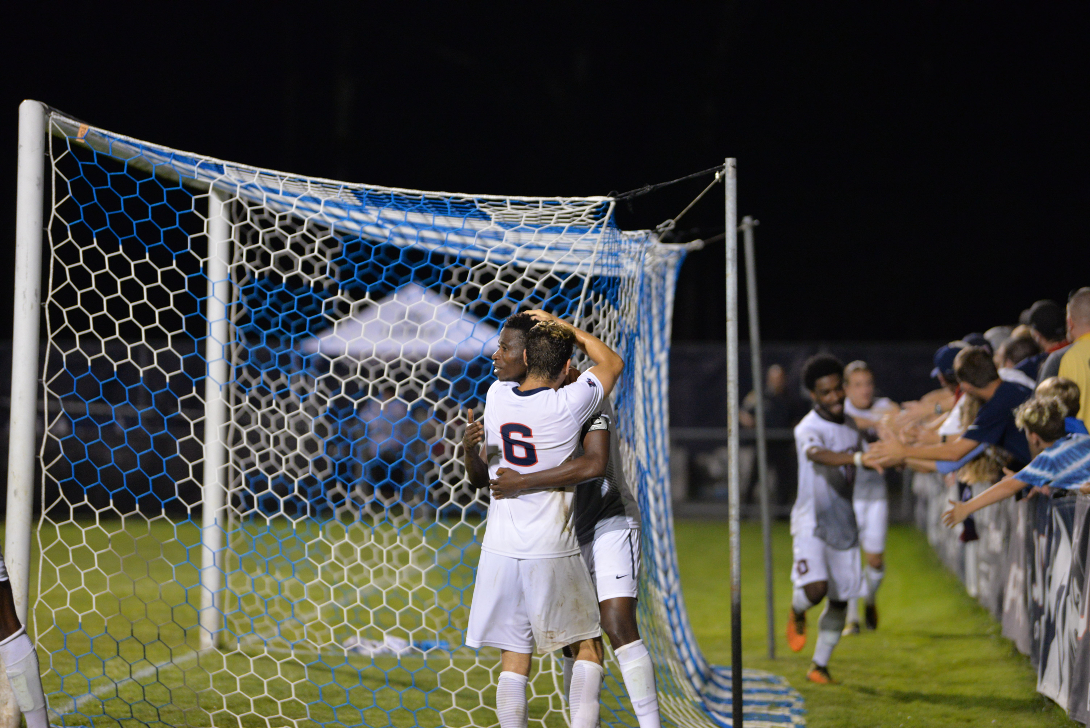 UConn's Abdou Mbacke Thiam and Dylan Greenberg celebrate after the game-winning goal Tuesday night. (Amar Batra/The Daily Campus)