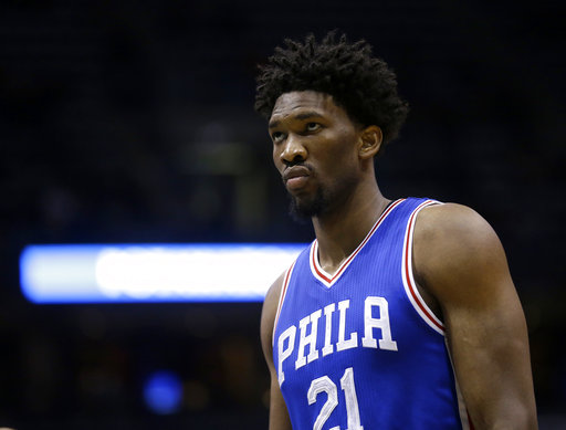 In this Jan. 16, 2017, file photo, Philadelphia 76ers' Joel Embiid watches during an NBA basketball game against the Milwaukee Bucks in Milwaukee. (AP Photo/Aaron Gash, File)