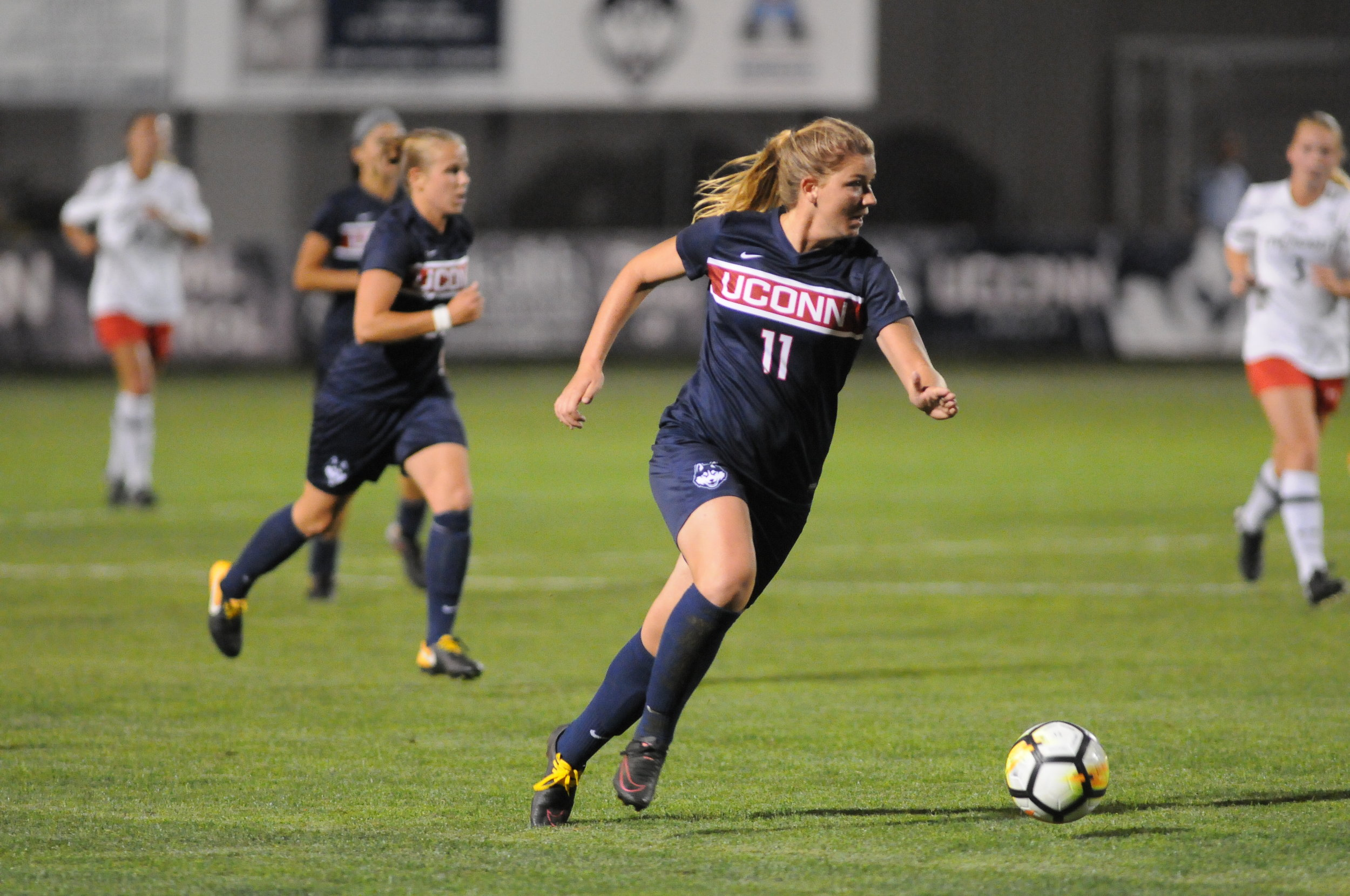 Kim Urbanek (11) charges down the field in the UConn Women's Soccer game against Providence on Sept 28, 2017. (Mark Wezenski/The Daily Campus)
