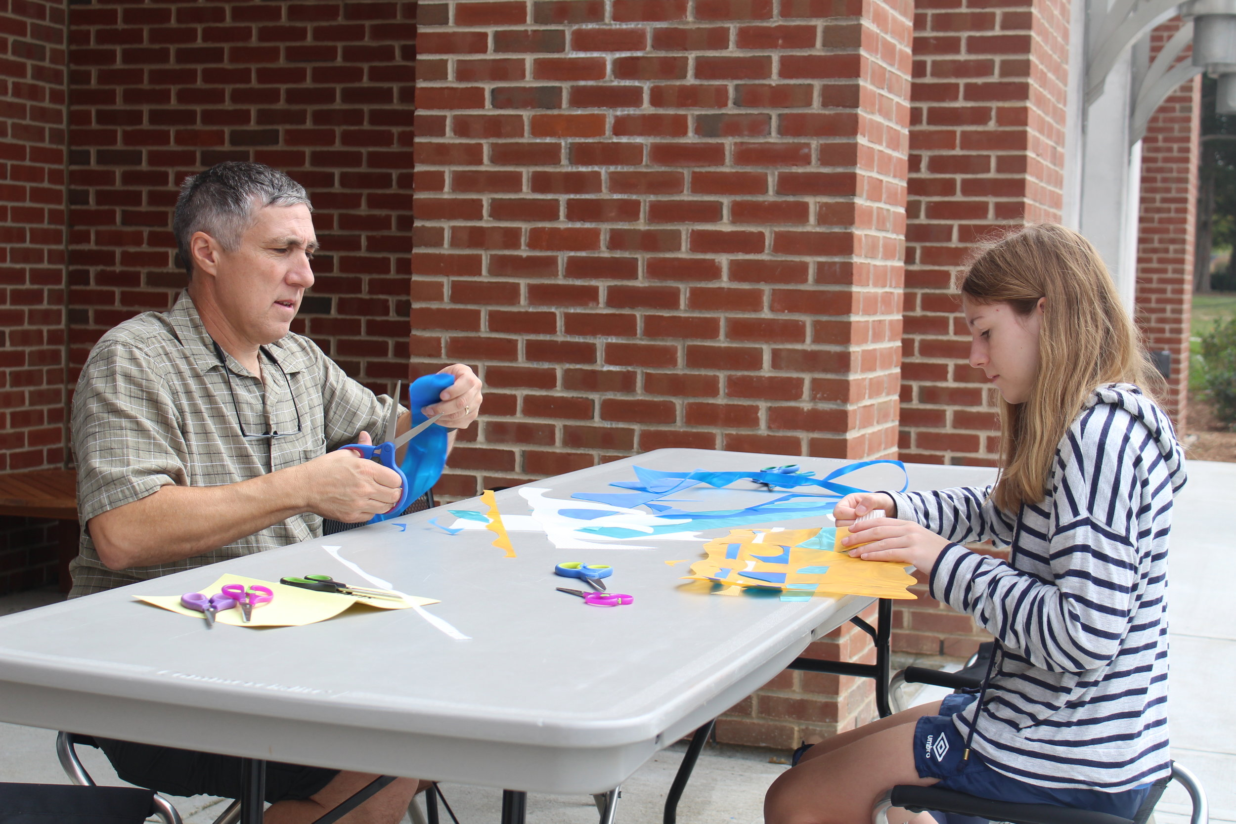 Families created waves for artists Susan Hoffman Fishman and Elena Kalman's interactive public art project, The Wave, celebrating water on Saturday, Oct. 7 for Family Weekend at the William Benton Museum of Art. (Kim Nguyen/The Daily Campus)