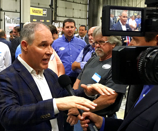 EPA Administrator Scott Pruitt, talks to a reporter after speaking at Whayne Supply in Hazard, Ky, Monday, Oct. 9, 2017. Pruitt says the Trump administration will abandon the Obama-era clean power plan aimed at reducing global warming. Connecticut will join several other states to defend the recently-repealed Clean Power Plan.(AP Photo/Adam Beam)