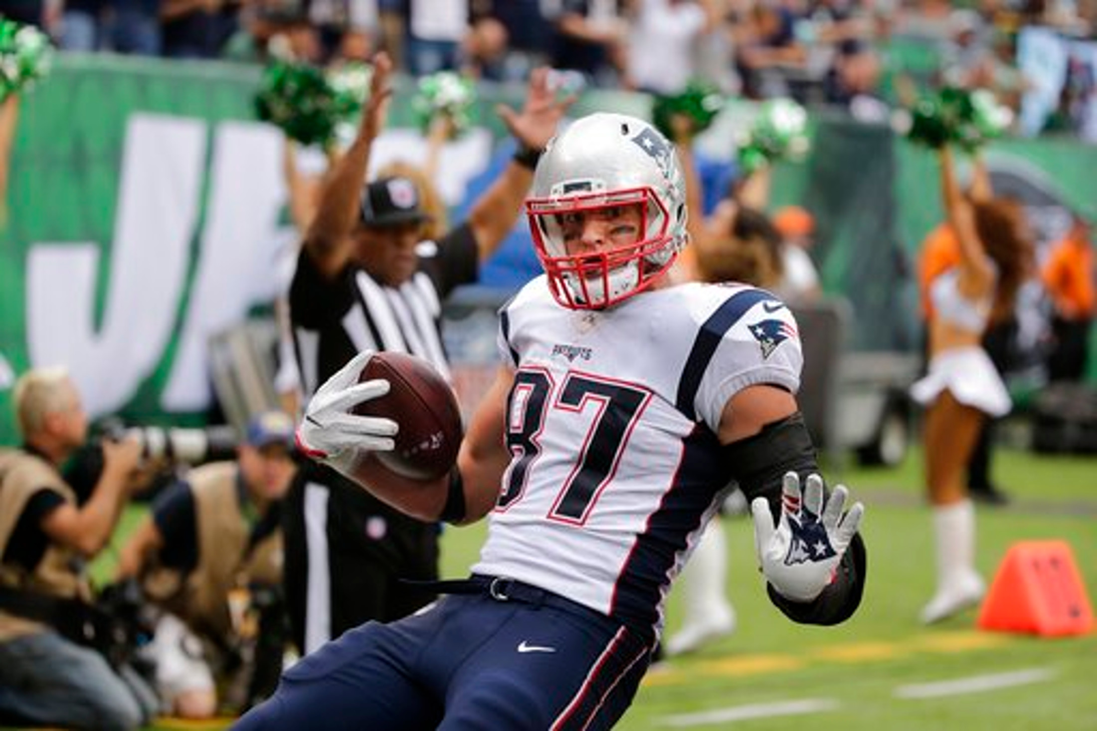 New England Patriots' Rob Gronkowski (87) runs away from New York Jets' Marcus Maye for a touchdown during the second half of an NFL football game, Sunday, Oct. 15, 2017, in East Rutherford, N.J. (Seth Wenig/AP Photo)