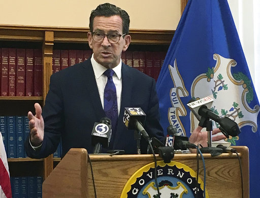 Connecticut Gov. Dannel P. Malloy speaks after top state legislative leaders said they had reached an agreement on a tentative framework for a new two-year budget, Wednesday, Oct. 18, 2017, at the Capitol in Hartford, Conn. (AP Photo/Susan Haigh)