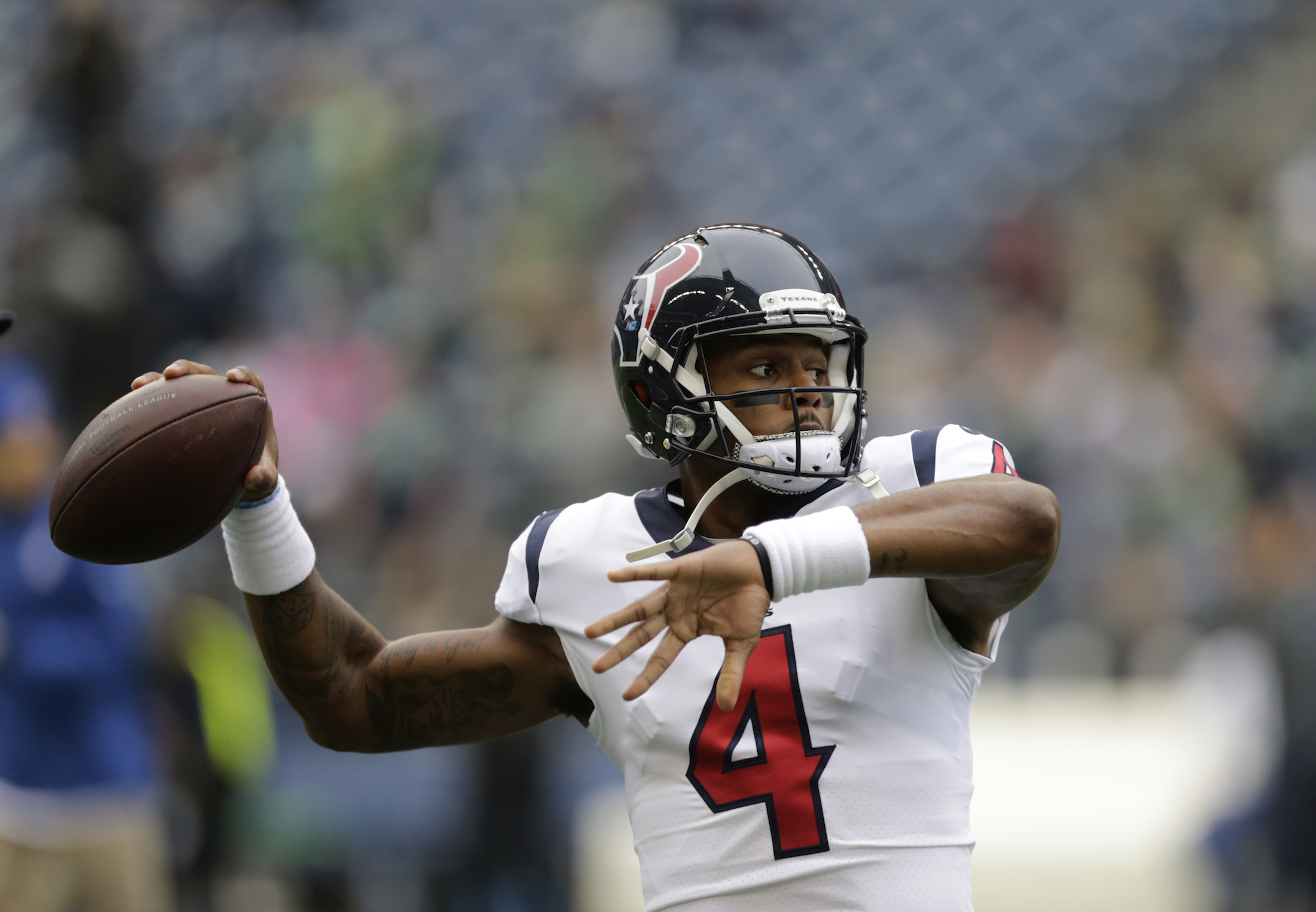 Houston Texans quarterback Deshaun Watson passes during warmups before an NFL football game against the Seattle Seahawks, Sunday, Oct. 29, 2017, in Seattle. (AP Photo/Stephen Brashear)