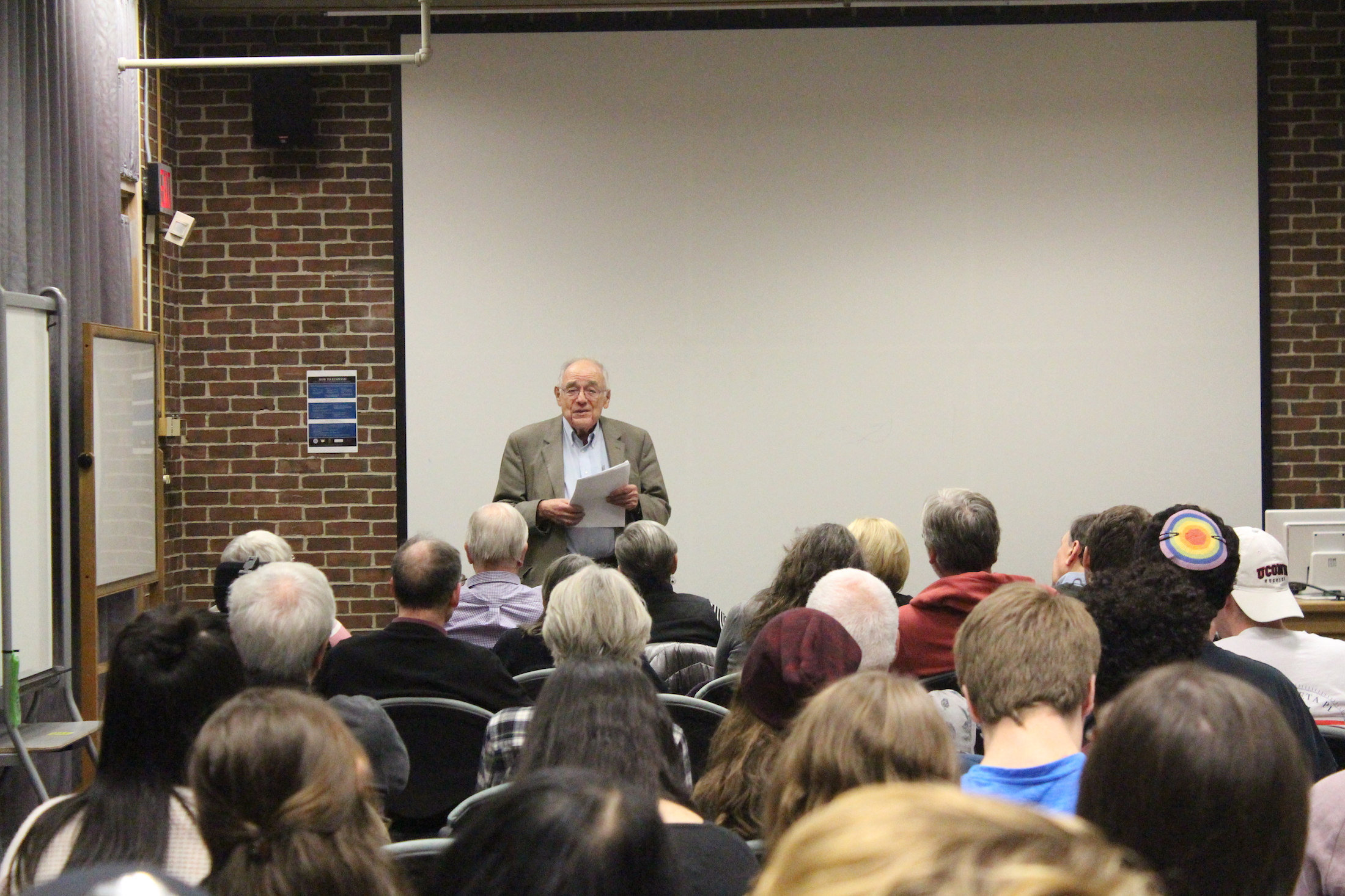 """Holocaust survivor Hans Laufer spoke at the Homer Babbidge Library before a screening of """"Denial"""" on Wednesday. (Ryan Murace/The Daily Campus)"""