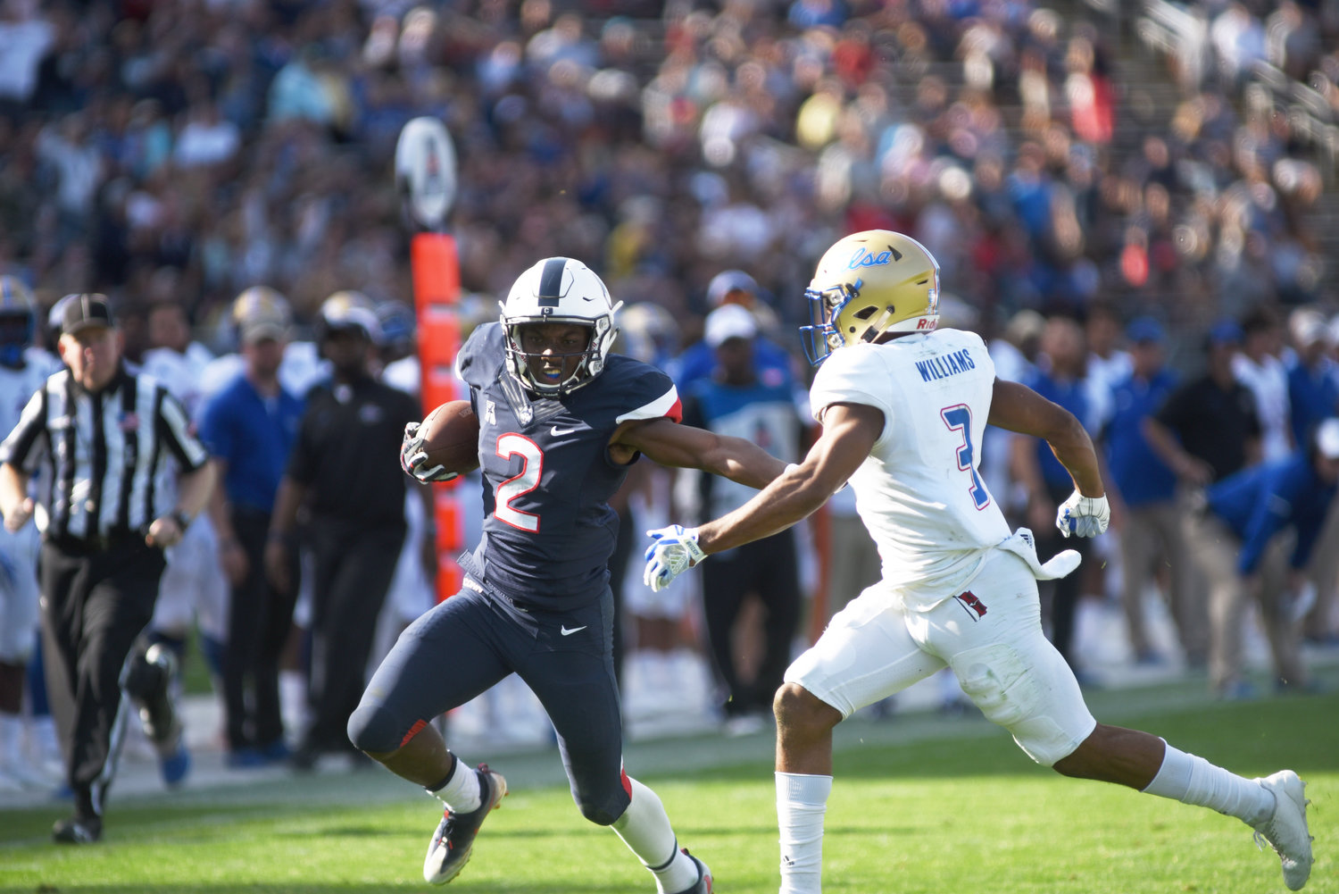 UConn wide receiver Tyraiq Beals stiff arms a Tulsa defender during the Huskies' 20-14 over Tulsa Saturday at Rentschler Field in East Hartford. (Charlotte Lao, Associate Photo Editor/The Daily Campus)